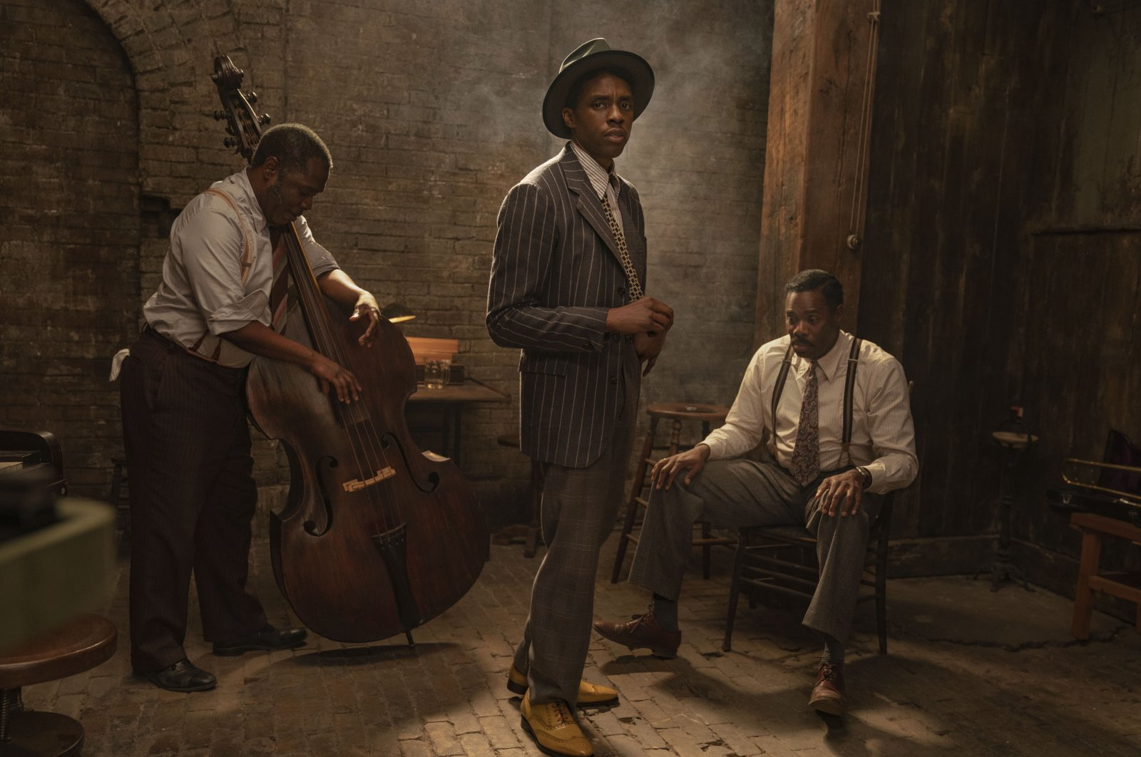 """This image released by Netflix shows Michael Potts (L), Chadwick Boseman and Colman Domingo in """"Ma Rainey's Black Bottom.""""  (AP Photo)"""