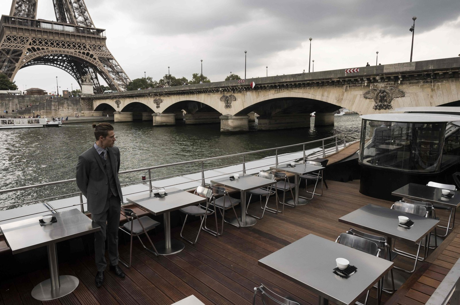 A waiter stands at French chef Alan Ducasse's new boat restaurant, Paris, France, Aug. 30, 2018. (AFP Photo)