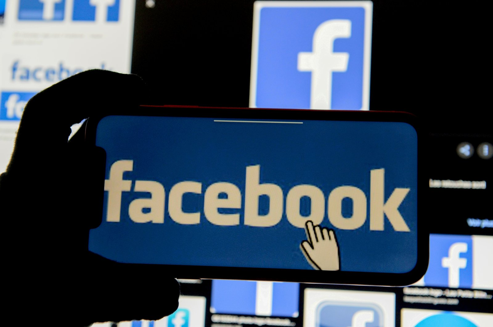 The Facebook logo is displayed on a mobile phone in this picture illustration, Dec. 2, 2019. (Reuters Photo)