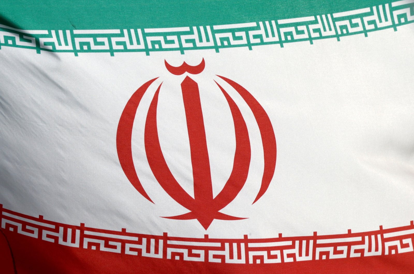 The Iranian flag waves in front of the International Atomic Energy Agency (IAEA) headquarters in Vienna, Austria, March 1, 2021. (Reuters Photo)