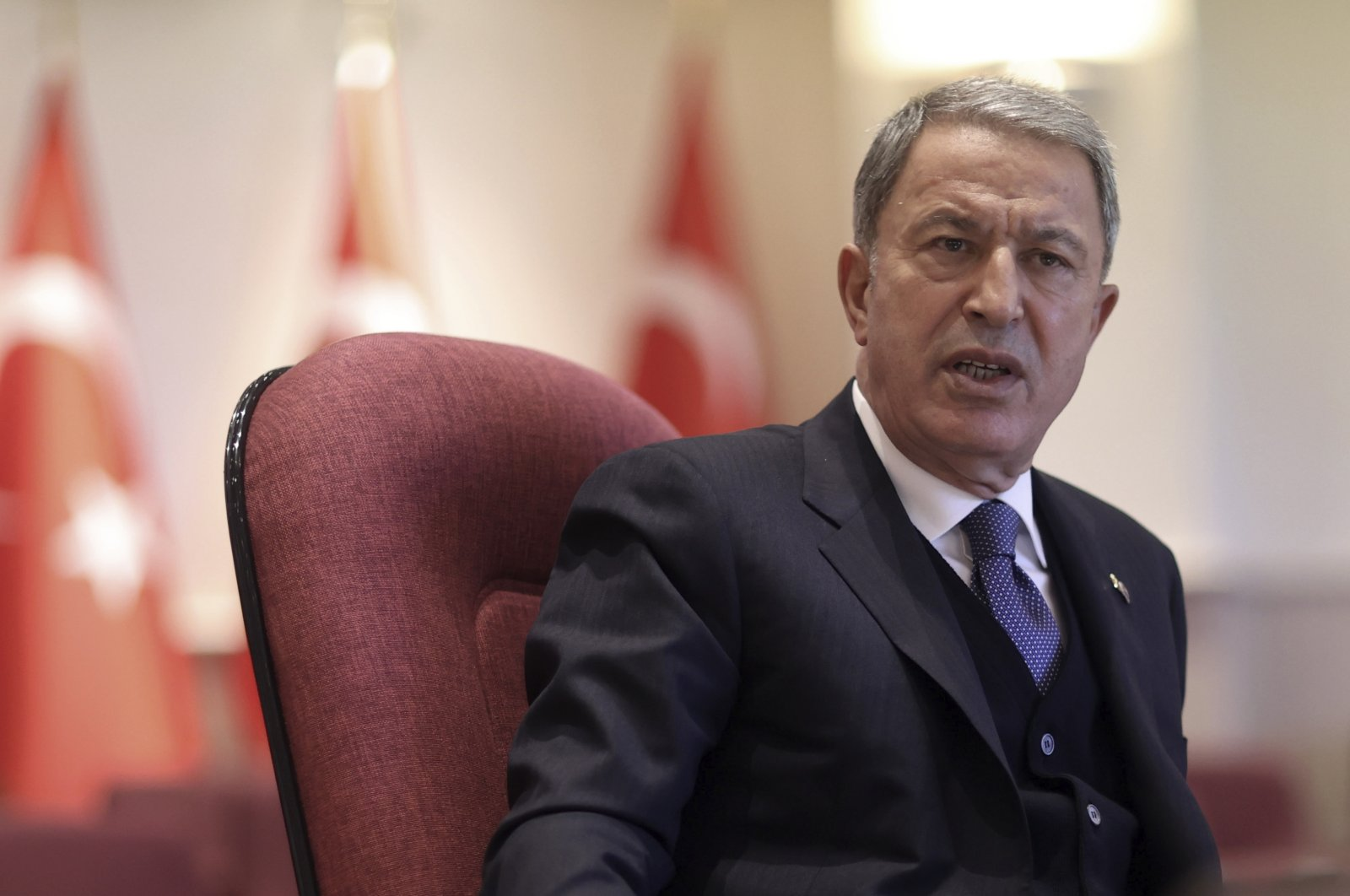 Turkish Defense Minister Hulusi Akar speaks during a news conference with a small group of journalists, in Ankara, Turkey, Jan. 13, 2021. (Defense Ministry via AP, Pool)
