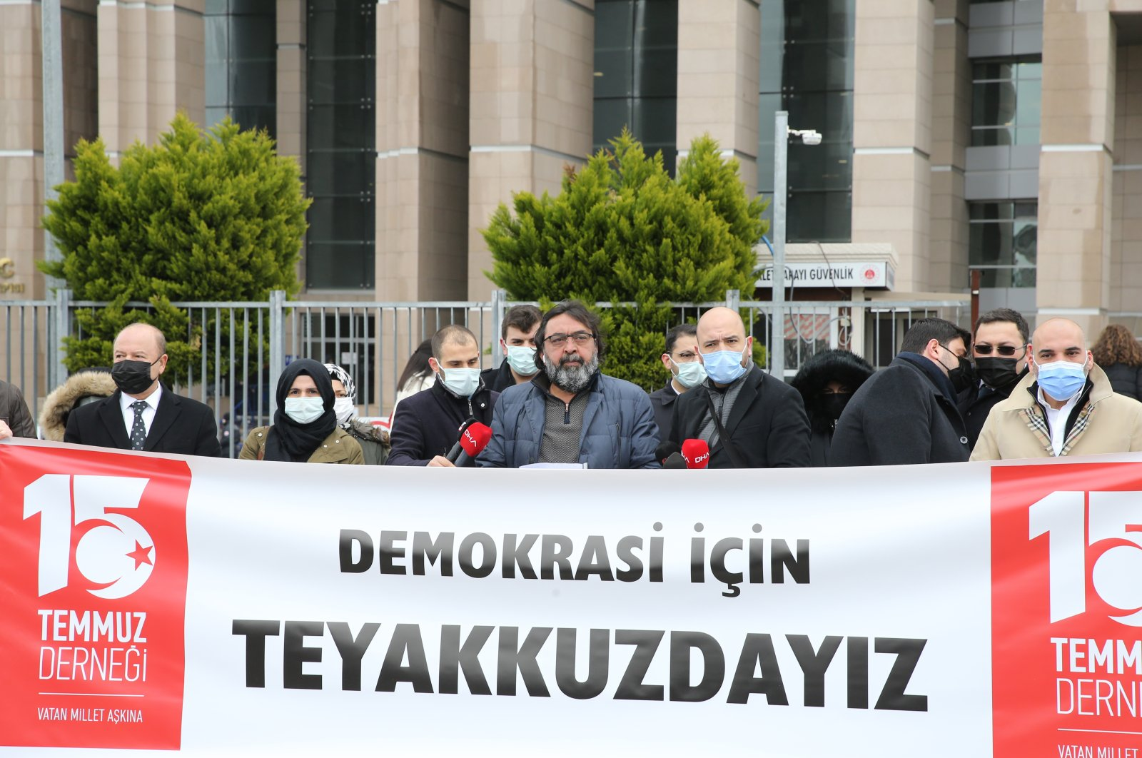 """People protest the retired admirals' declaration as they hold a banner that reads """"We are on the alert for democracy,"""" in Istanbul, Turkey, April 5, 2021. (AA Photo)"""