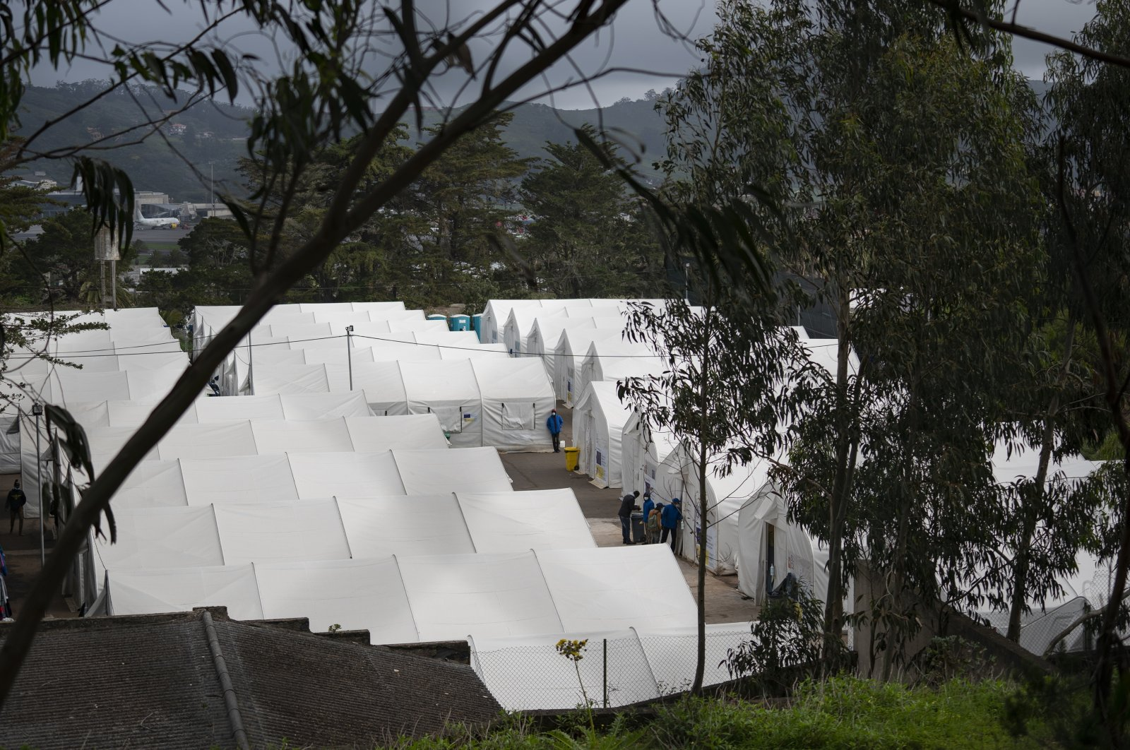 Several tents can be seen in Las Raices camp in San Cristobal de la Laguna, in the Canary Island of Tenerife, Spain, March 18, 2021. (AP Photo)