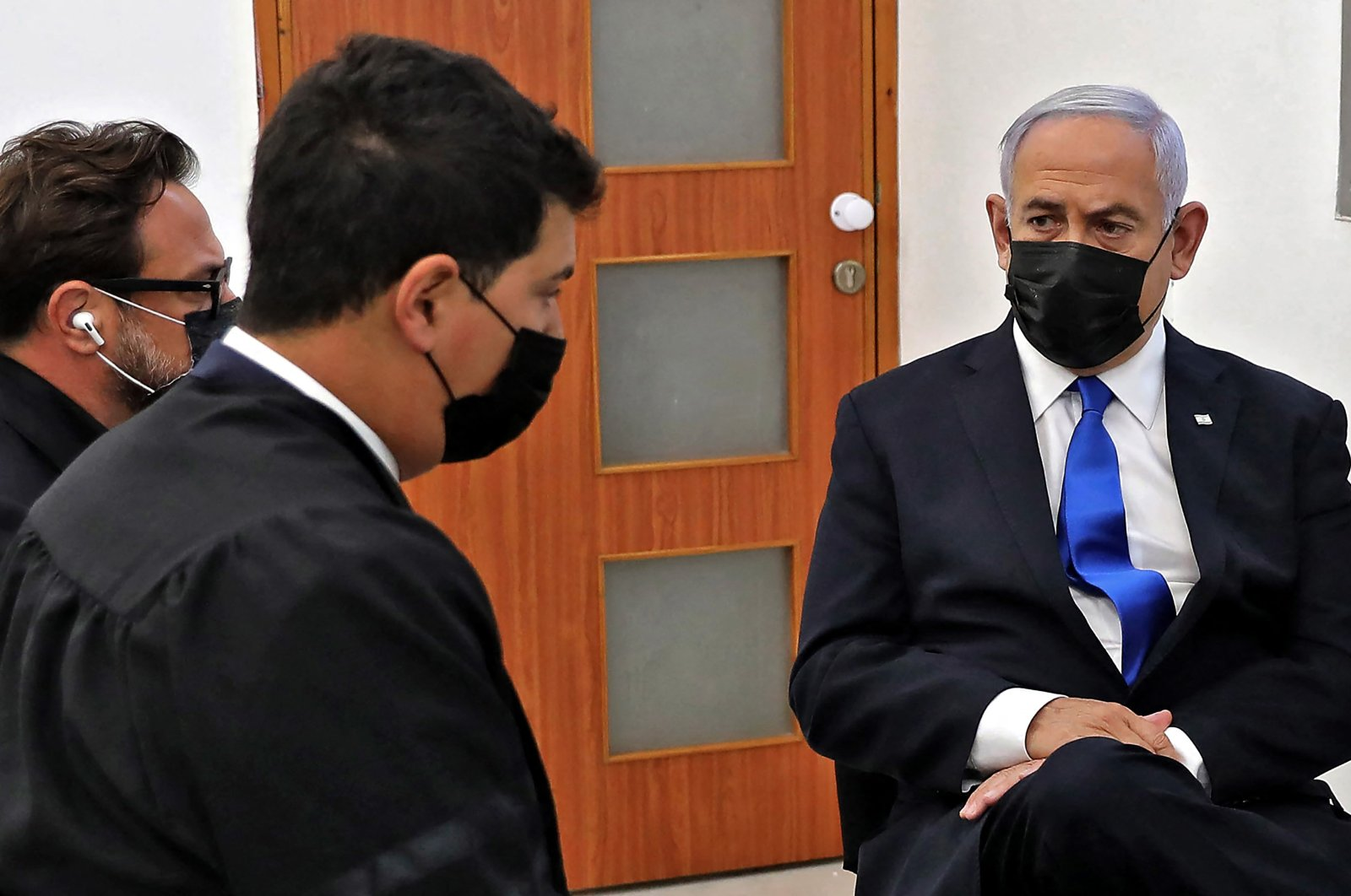 Israeli Prime Minister Benjamin Netanyahu (R) attends the hearing for his corruption trial at district court in Jerusalem on April 5, 2021. (AFP Photo)