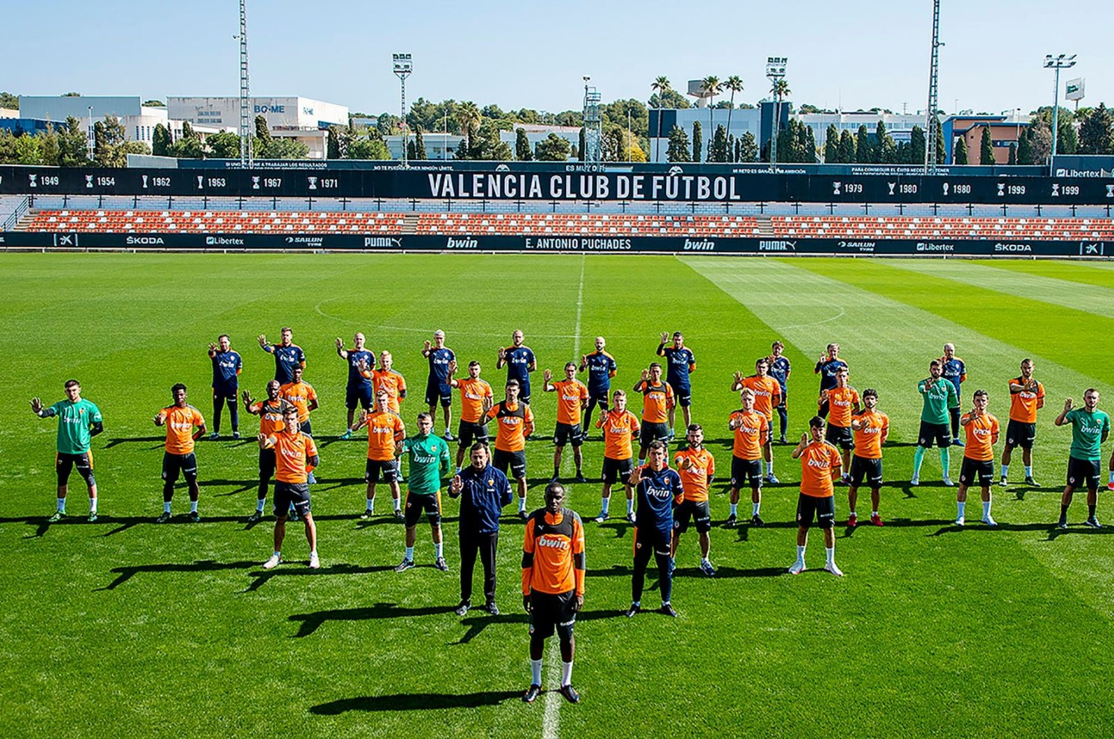 A handout picture released by the Valencia football club shows players and staff showing their support to Valencia's French defender Mouctar Diakhaby (C) as they protest against racism during a training session in Valencia, Spain, April 5, 2021. (VALENCIA CF / AFP Photo)