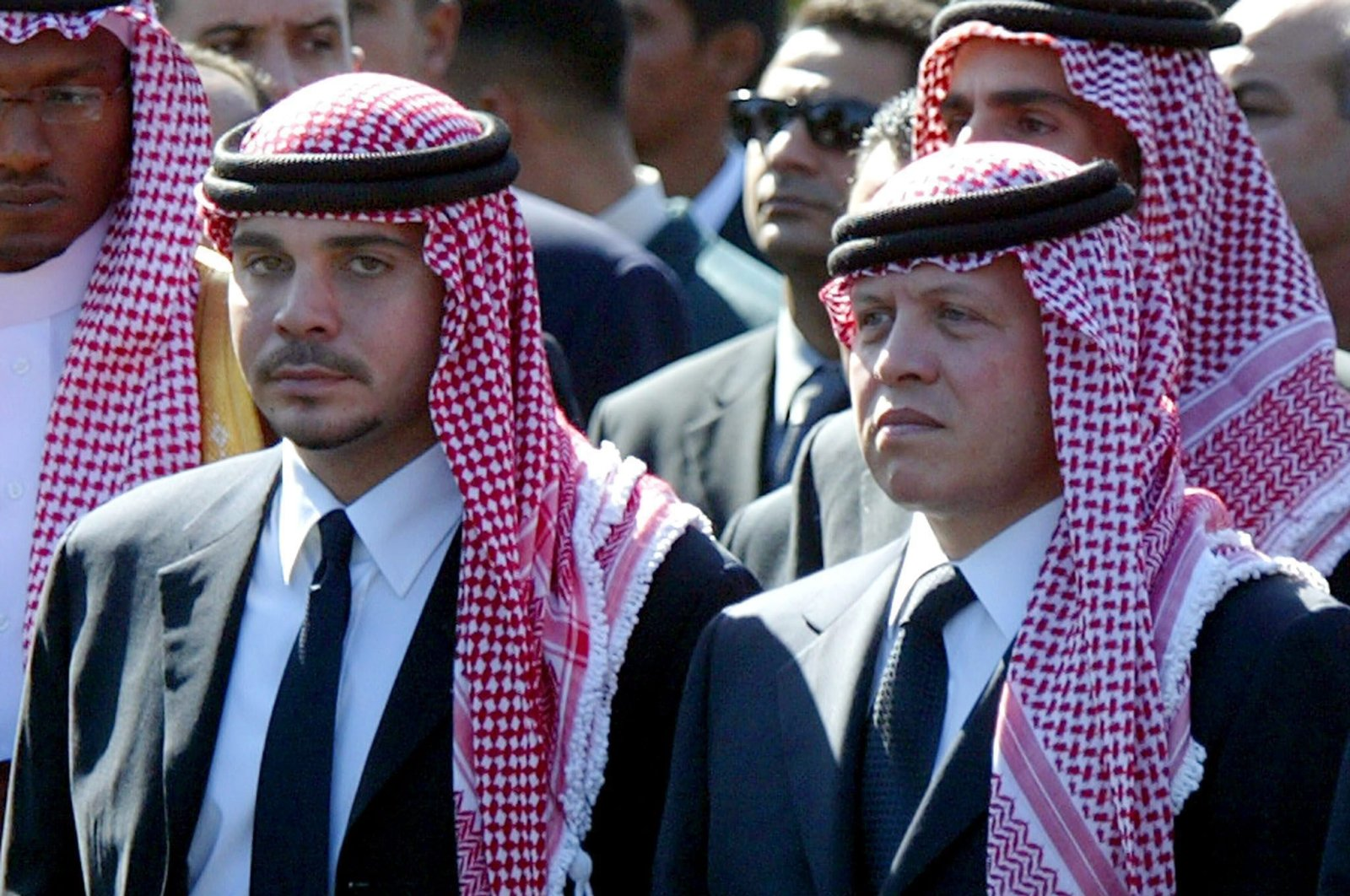 Former Jordanian Crown Prince Hamzah bin Al Hussein (L) with his half-brother King Abdullah II of Jordan (R) as they walk together in the funeral procession of Palestinian President Yasser Arafat in Cairo, Egypt, 12 Nov. 12, 2004.  (EPA-EFE/MIKE NELSON)