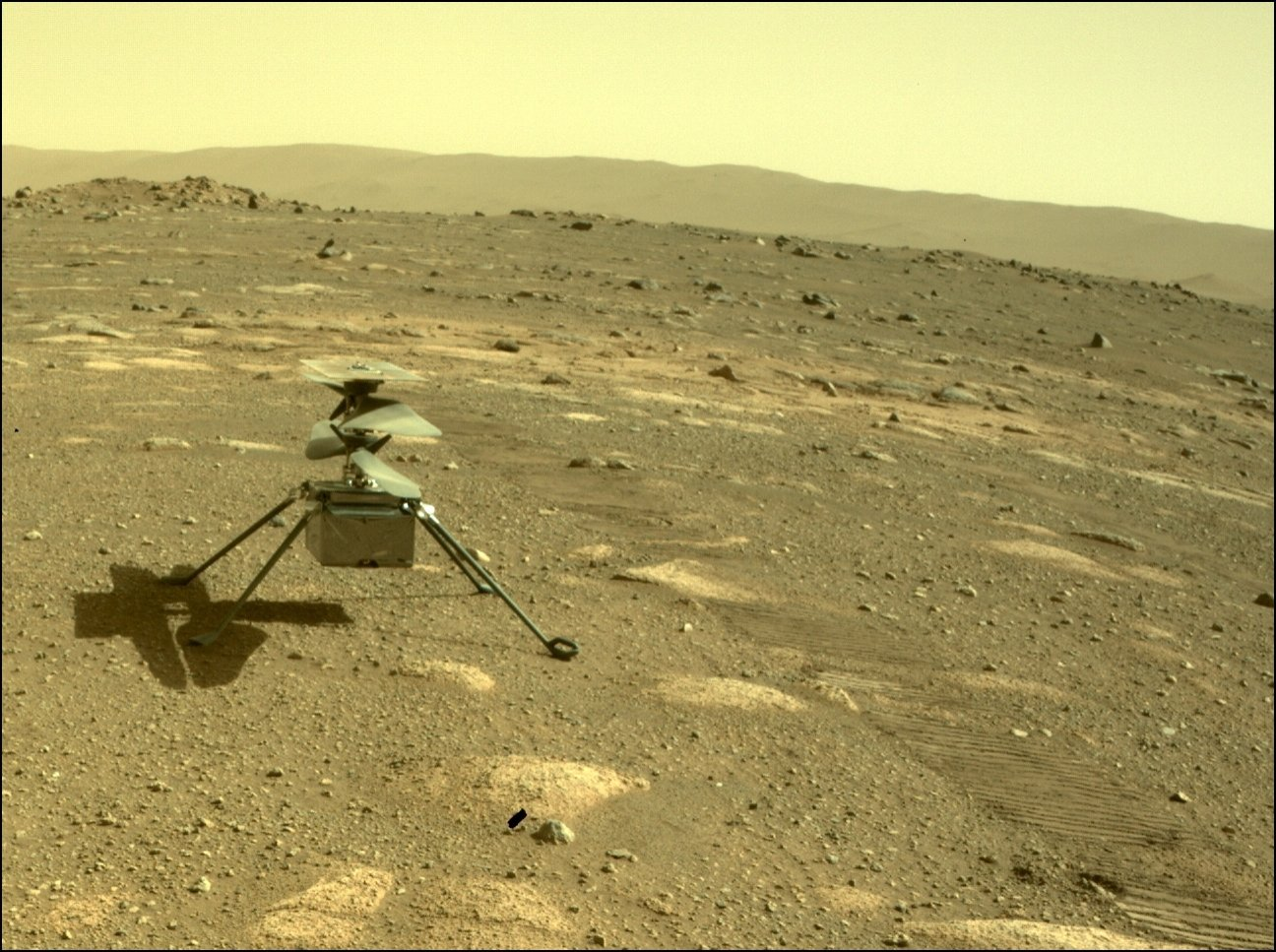 A handout photo made available by NASA shows the Ingenuity Helicopter after it was detached from NASA's Perseverance Mars rover, 04 April 2021. (EPA/NASA/JPL-Caltech HANDOUT)