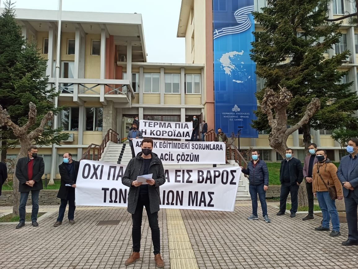 Parents and their supporters take part in a demonstration protesting the Greek government's postponement of community board member elections at minority schools in Komotini (Gümülcine), northern Greece, April 6, 2021. (AA Photo)