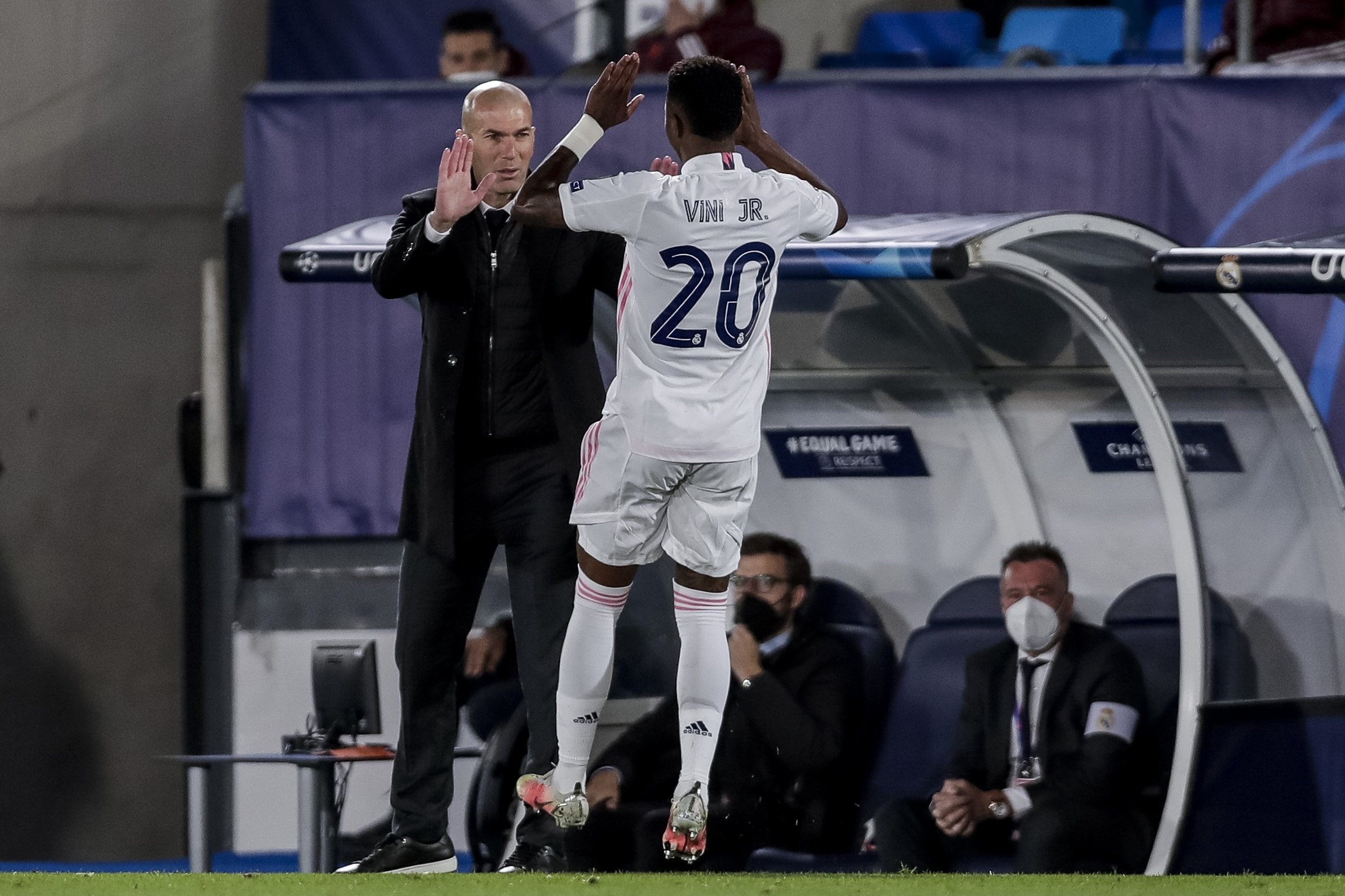 Real Madrid's Vinicius Junior (R) is congratulated by Real Madrid's head coach Zinedine Zidane after scoring during the Champions League quarterfinal first leg, football match between Real Madrid and Liverpool at the Alfredo di Stefano stadium in Madrid, Spain, Tuesday, April 6, 2021. (AP Photo)