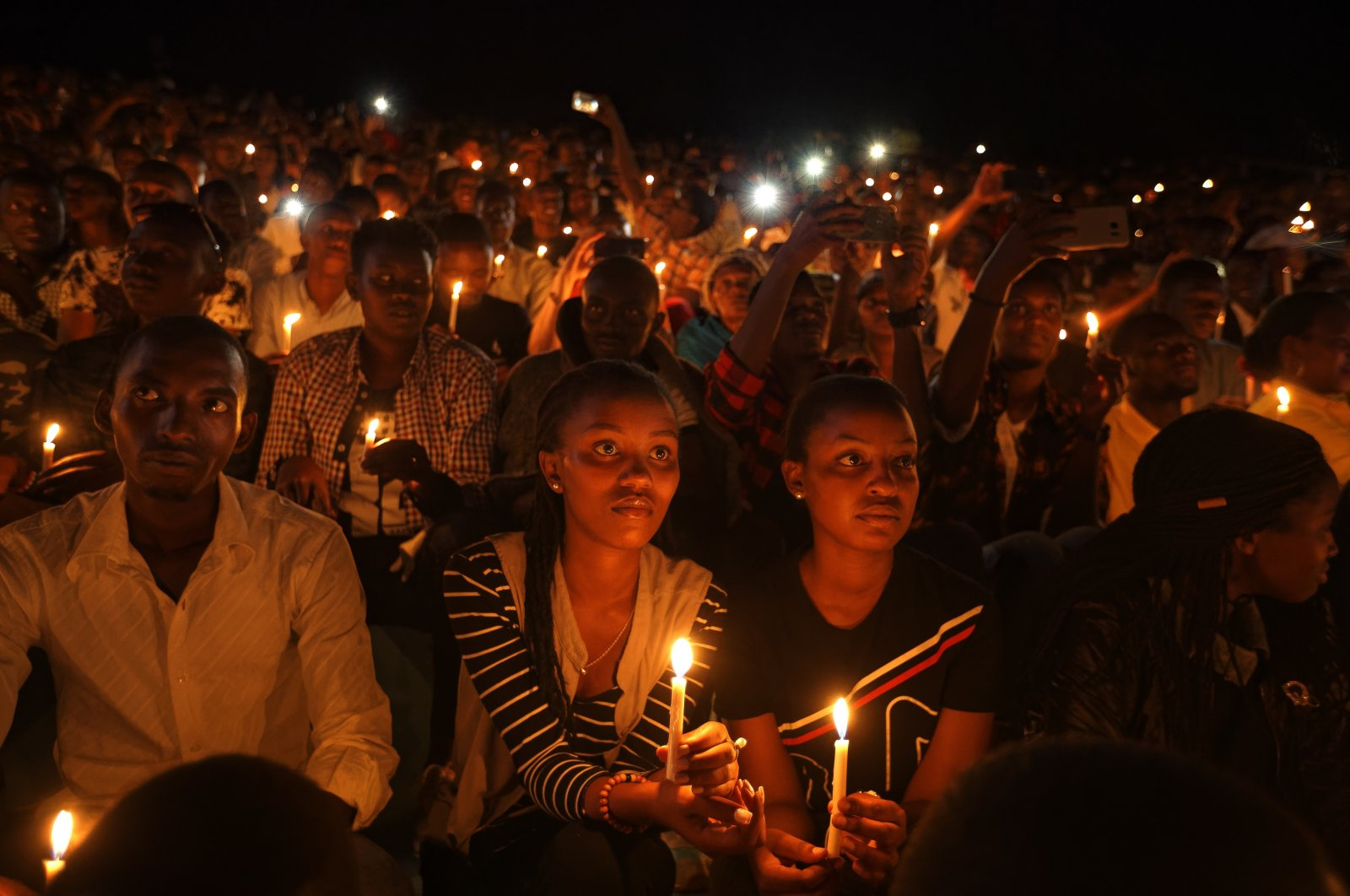 People attend a candlelight vigil during a memorial service marking 25 years since the 1994 Rwanda genocide, at Amahoro stadium in the capital Kigali, Rwanda, April 7, 2019. (AP Photo)