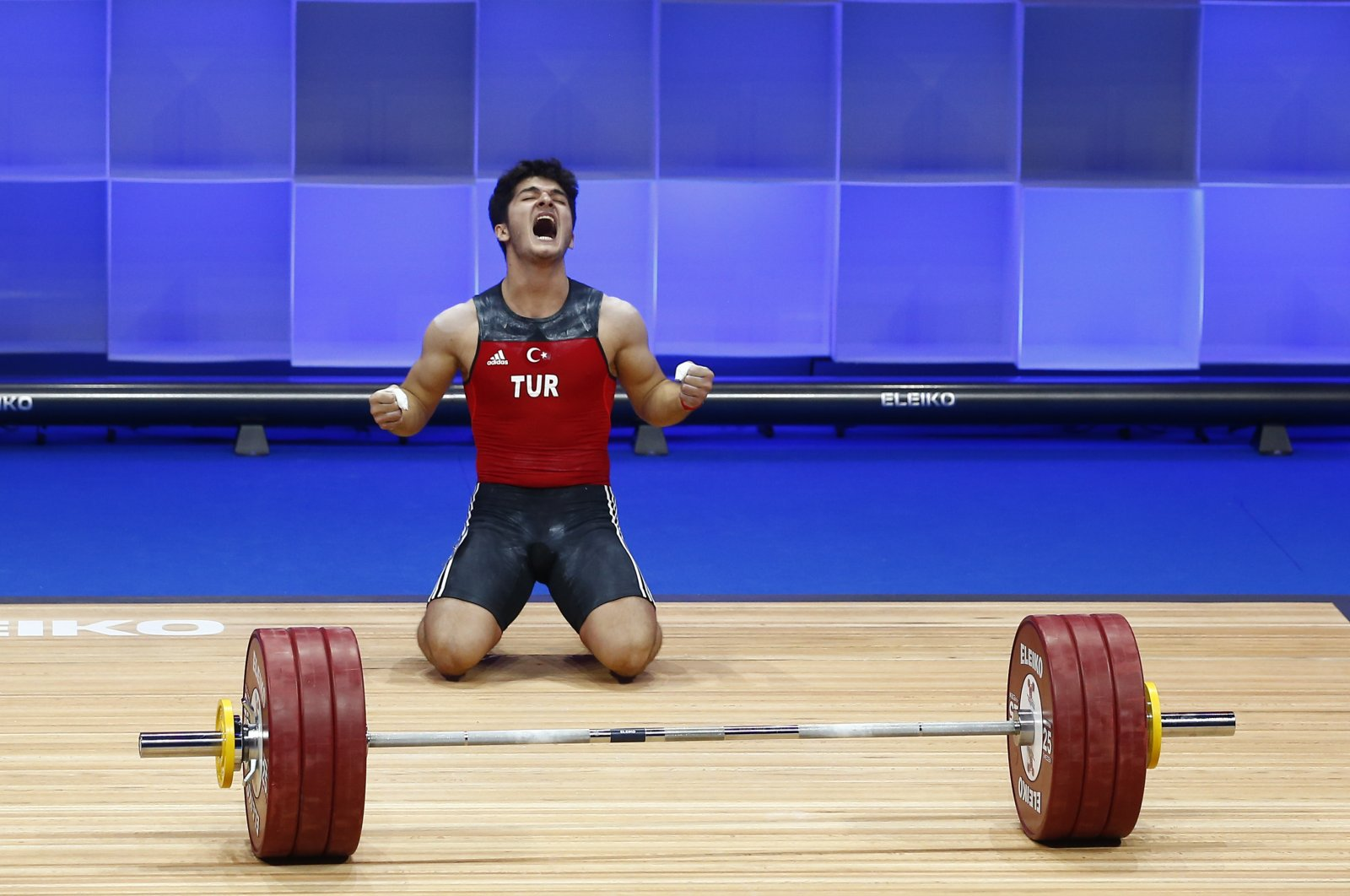 Turkish weightlifter Muhammed Özbek celebrates after winning gold at the European Weightlifting Championships in Moscow, Russia, April 5, 2021. (AA Photo)