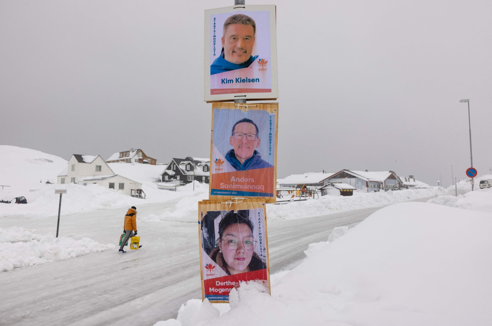 Election campaign posters with candidates for the legislative elections of the Siumut party, including Greenland's Prime Minister Kim Kielsen (top), are plastered on a lamppost in Nuuk, Greenland, April 5, 2021. (AFP Photo)