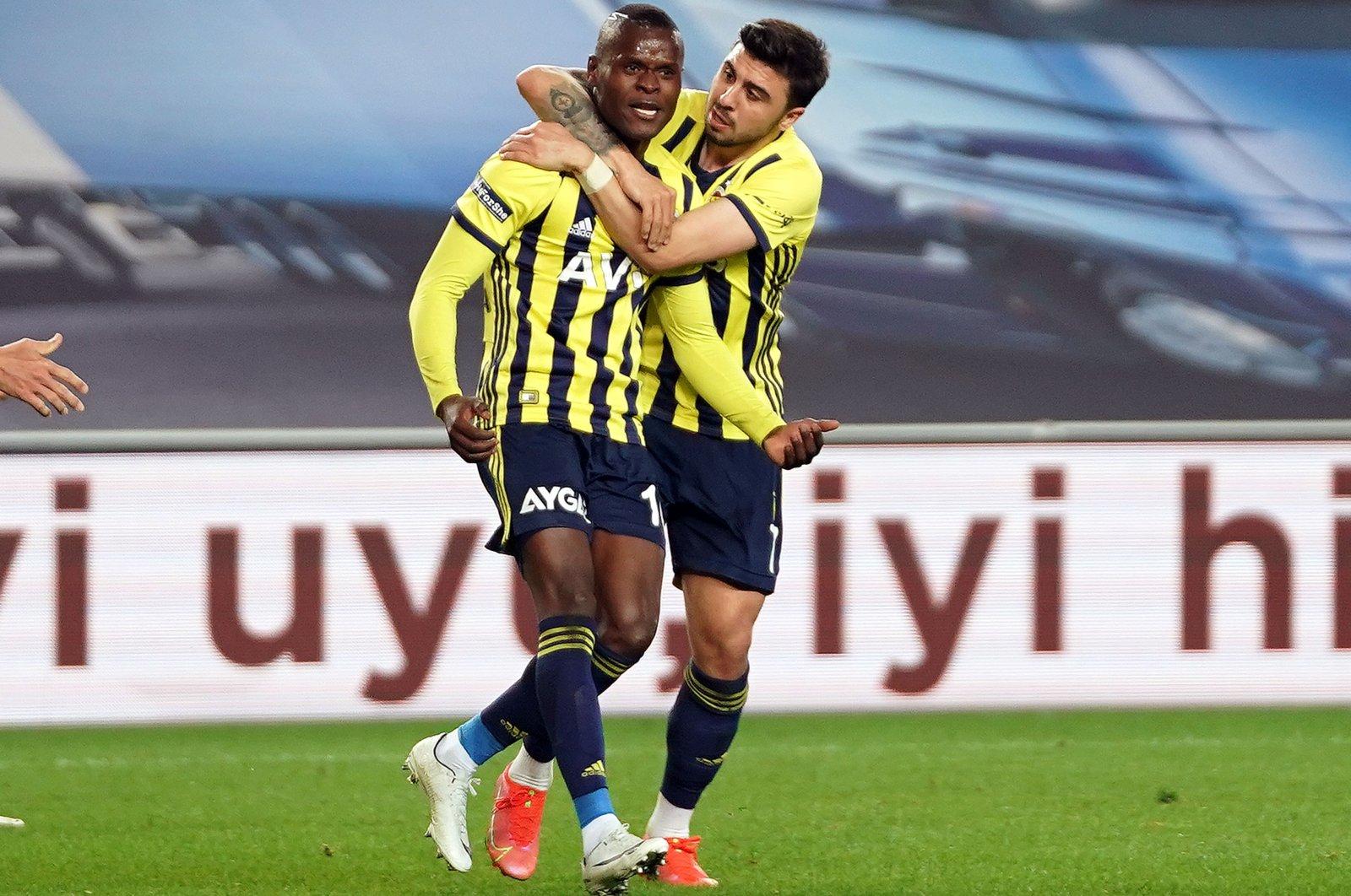 Fenerbahçe strikerMbwana Samatta (L) celebrates with teammate Ozan Tufan after scoring a goal against Denizlispor in the Turkish Süper Lig, Istanbul, Turkey, April 5, 2021.