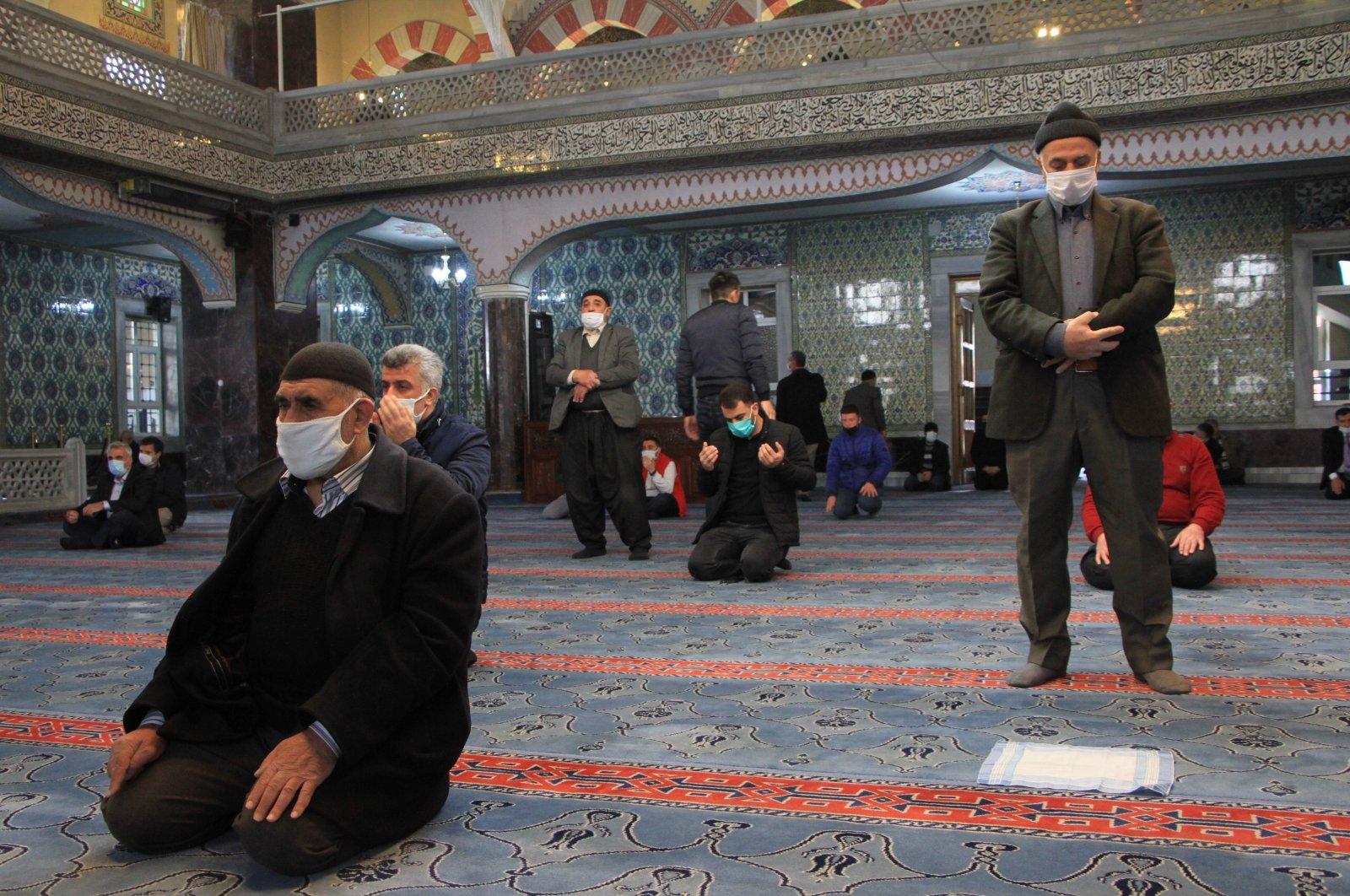 People perform prayers at a mosque in Elazığ, eastern Turkey, April 2, 2021. (IHA PHOTO)