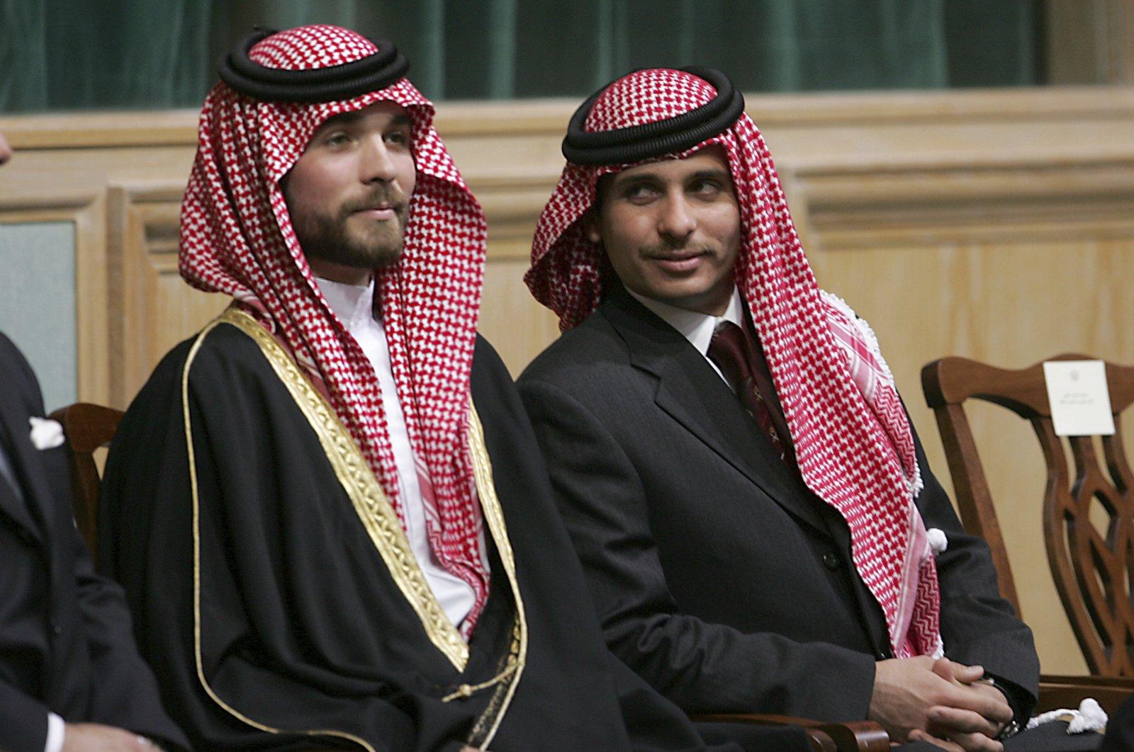 Former Crown Prince Hamzah (R) and Prince Hashem, half brothers of King Abdullah II of Jordan, attend the opening of the parliament in Amman, Jordan, Nov. 28, 2006. (AP Photo)