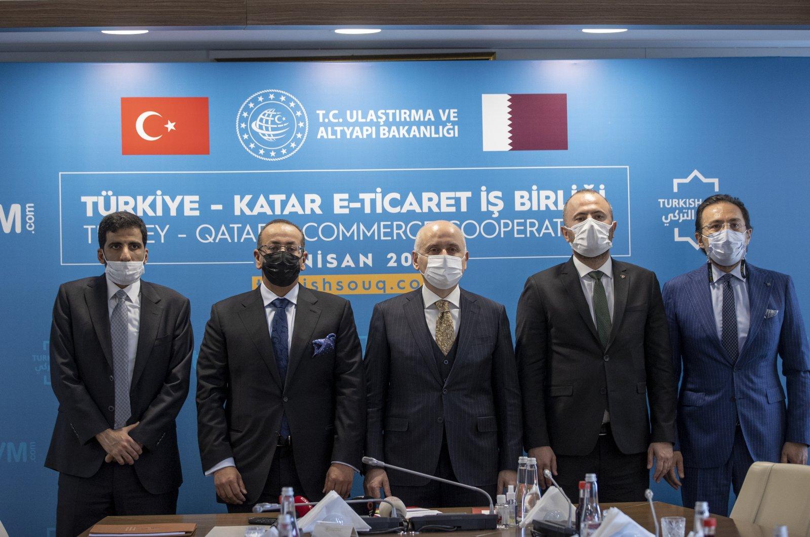 Qatar Post CEO Faleh al Naemi (2nd L) and Transportation and Infrastructure Minister Adil Karaismailoğlu (C) at a meeting for the Turkey-Qatar e-Trade Cooperation Project, Ankara, Turkey, April 6, 2021. (AA Photo)