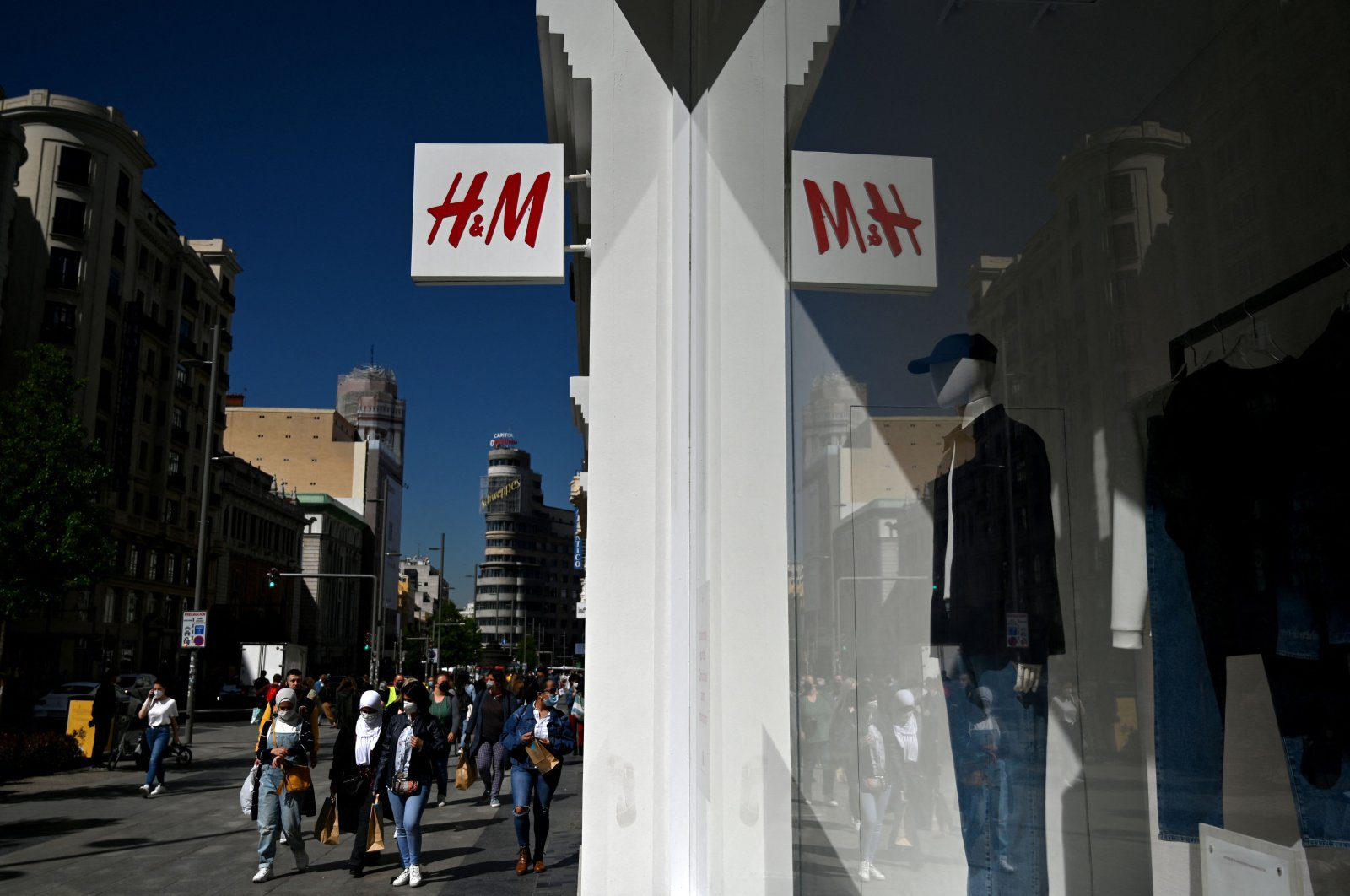 The logo of Swedish fashion retailer H&M is pictured outside a store in Madrid, Spain, April 6, 2021. (AFP Photo)