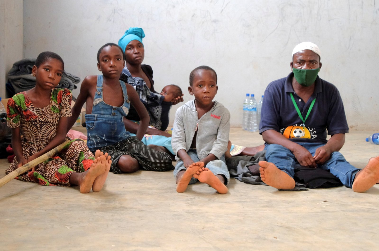 Adelino Alberto and his family, who fled an attack claimed by Daesh-linked insurgents on the town of Palma, are seen at a temporary displacement center in Pemba, Mozambique, April 3, 2021. (REUTERS Photo)