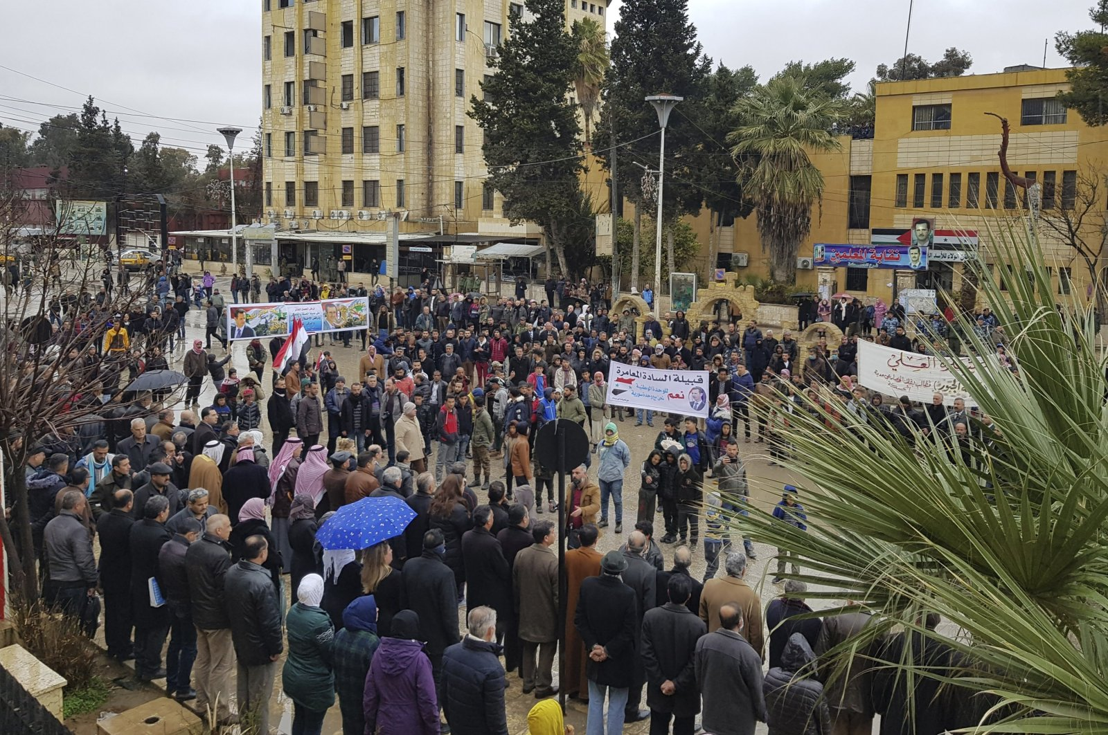 Pro-regime demonstrators protest the siege on their neighborhood by YPG forces, in Hassakeh, Syria, Jan. 31, 2021. (AP Photo)