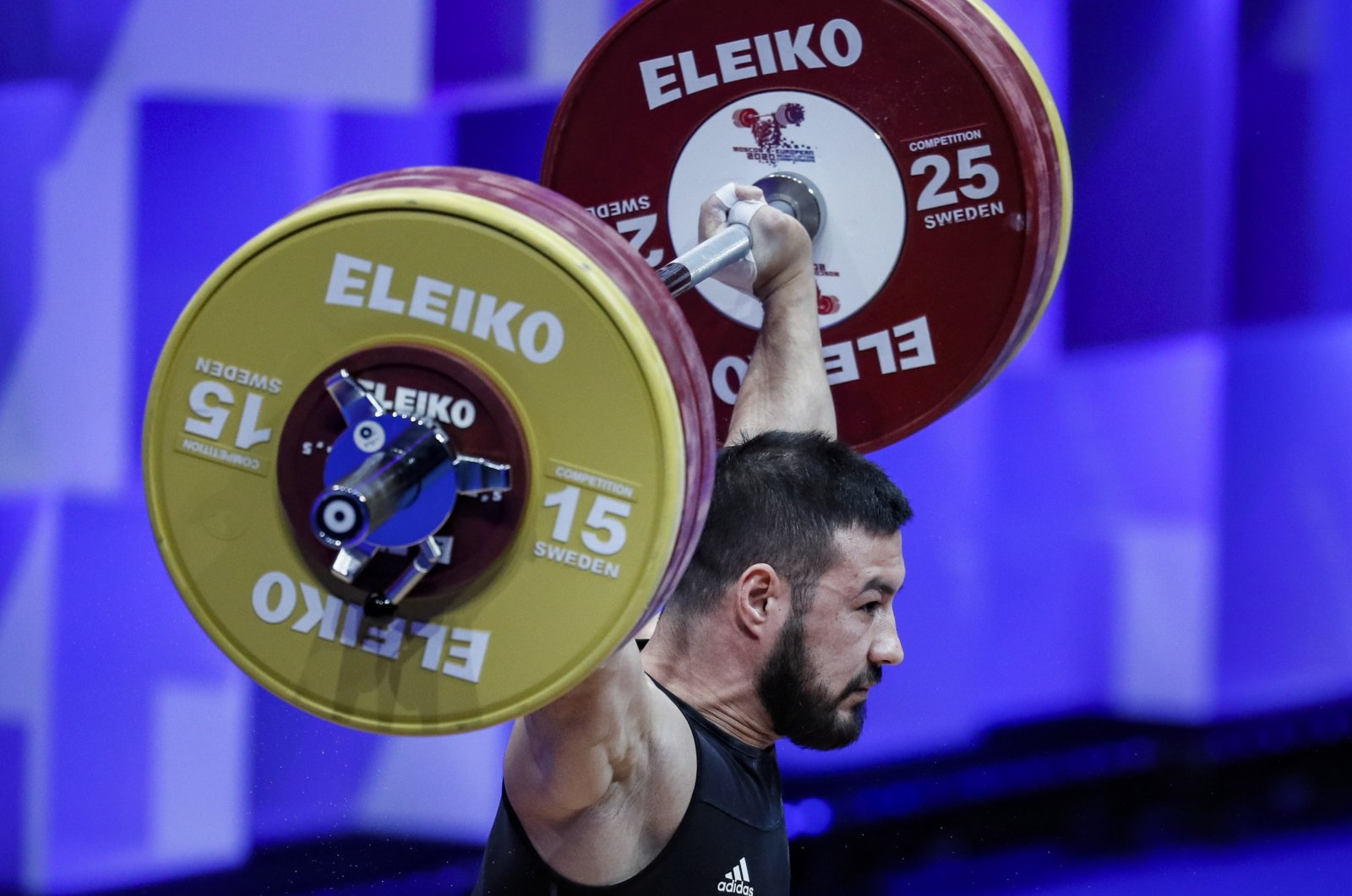 Daniyar Ismailov of Turkey in action during the men's 73-kilogram category final at the 2021 EWF European Weightlifting Championships, in Moscow, Russia, April 6, 2021. (EPA Photo)