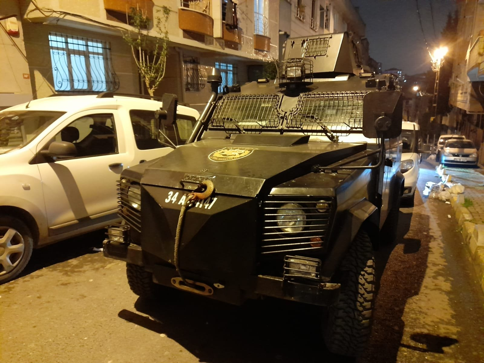 An armored police vehicle pictured in front of an apartment building in Istanbul's Bağcılar district, Istanbul, Turkey, April 7, 2021. (DHA Photo)