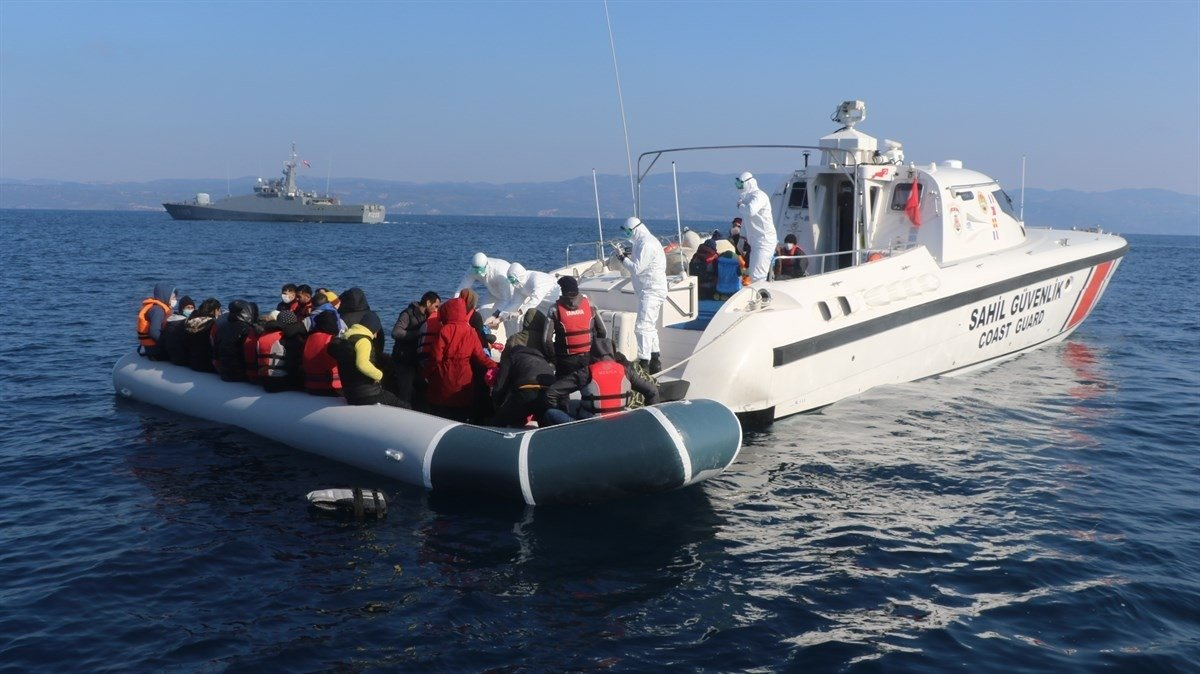 Irregular migrants pushed back by Greece are rescued by the Turkish coast guard in the Aegean Sea near Turkey's western province of Balıkesir, April 3, 2021. (İHA Photo)