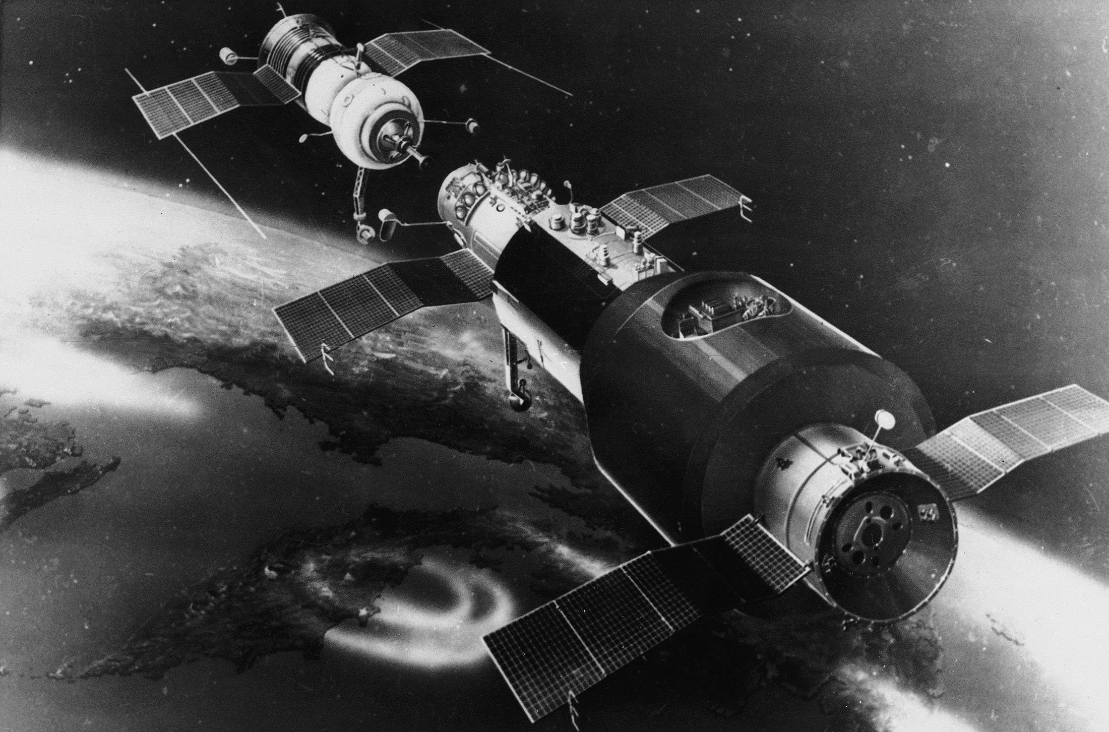 This is an artist's concept of Soyuz 11 and the Salyut spacecraft, preparing to dock in space, 1971. (AP Photo)