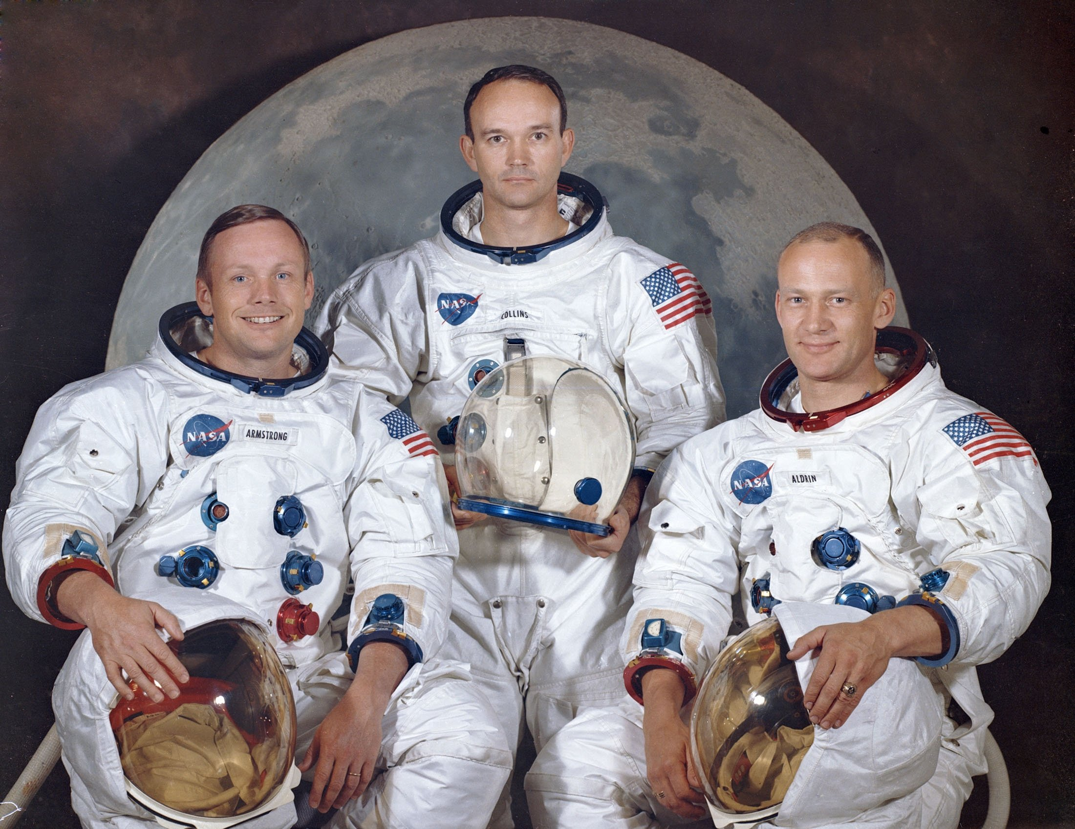 This March 30, 1969 photo shows the crew of the Apollo 11, from left, Neil Armstrong, commander; Michael Collins, module pilot; Edwin E. 'Buzz' Aldrin, lunar module pilot. (NASA via AP)