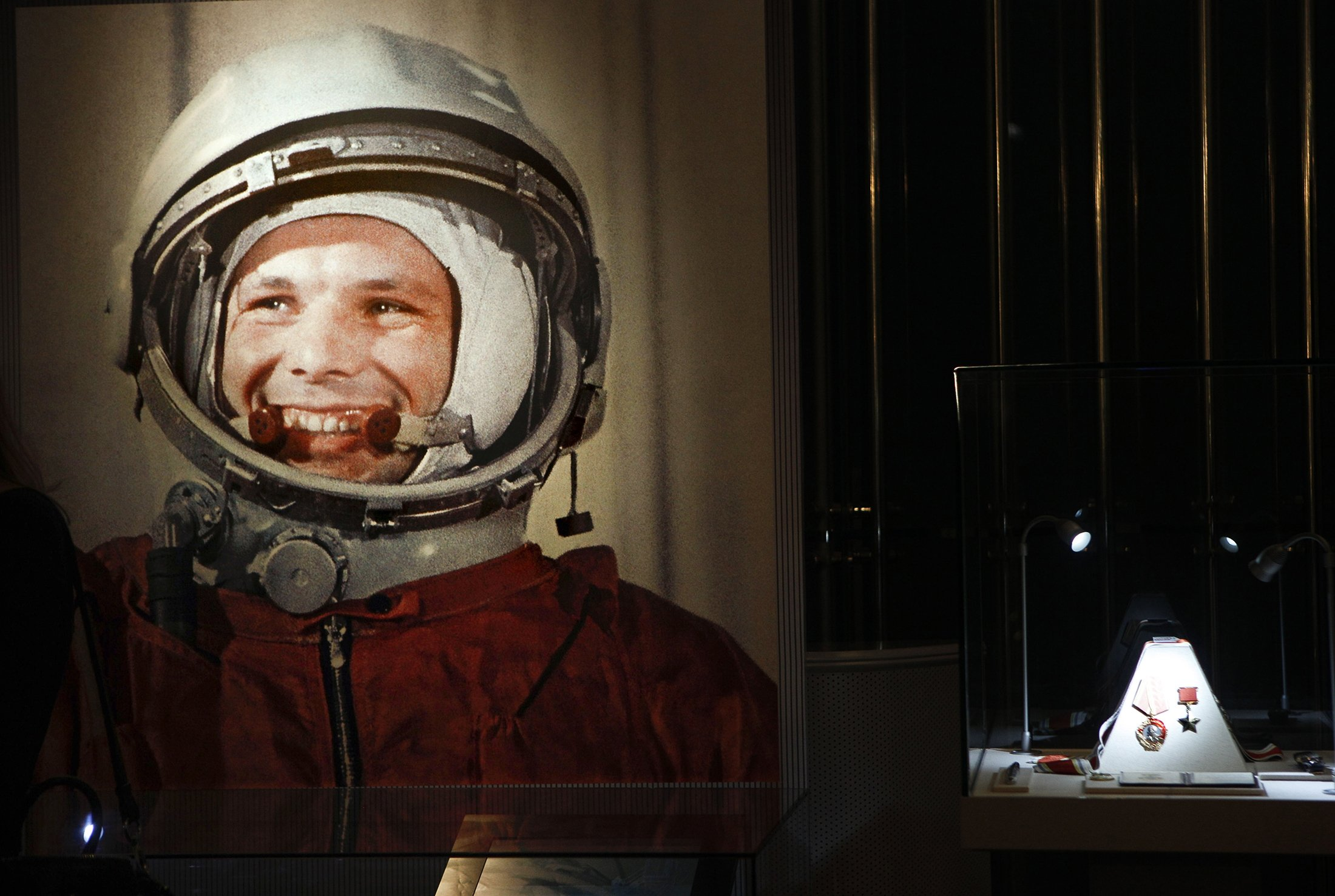 In this file photo taken on April 11, 2011, an undated portrait of the first man in space, Yuri Gagarin, and his award of the Hero of the Soviet Union, at right, part of an exhibition dedicated to the 50th anniversary of the first man in space, in Moscow, Russia. (AP Photo)
