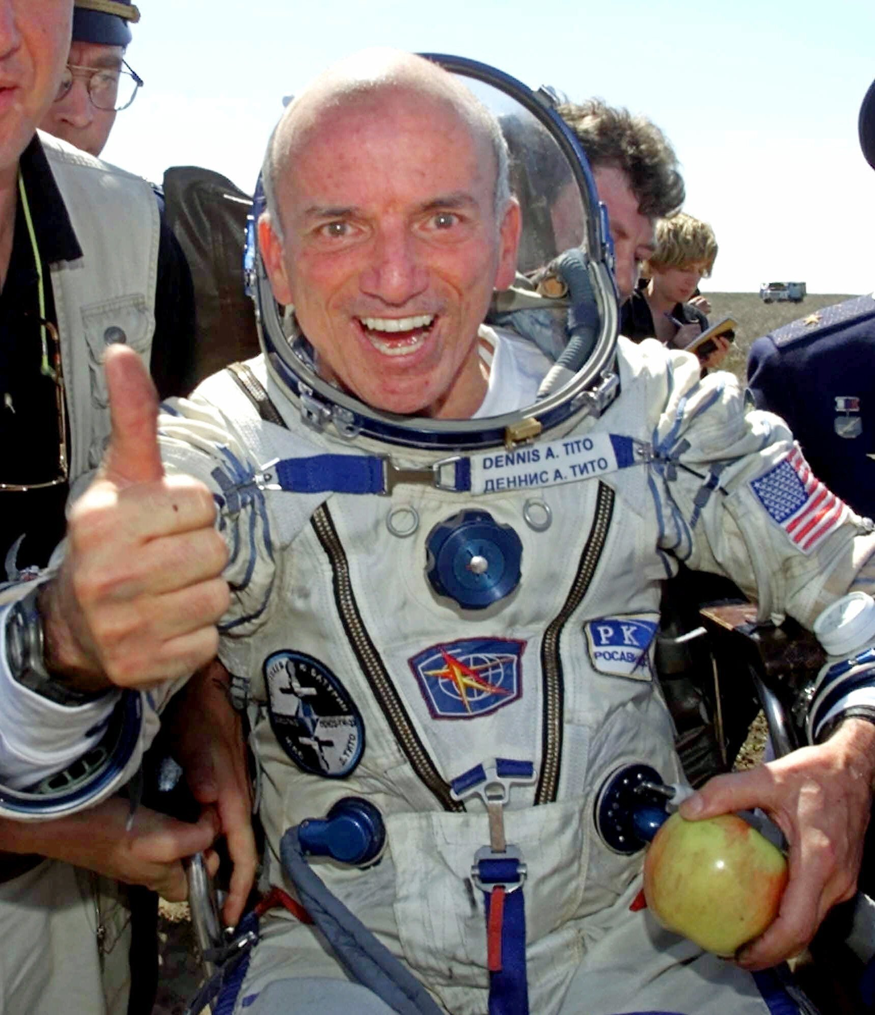 In this Sunday, May 6, 2001 file photo, U.S. multimillionaire Dennis Tito gives a thumbs up shortly after his landing in the Central Asian steppes, 80 kilometers (50 miles) northeast of Arkalyk, Kazakstan. (AP Photo)