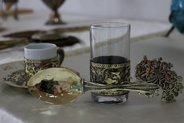 Cups and a spoon decorated with Roman mosaic patterns at the Continuation Institute, Adana, southern Turkey, April 6, 2021. (AA Photo)