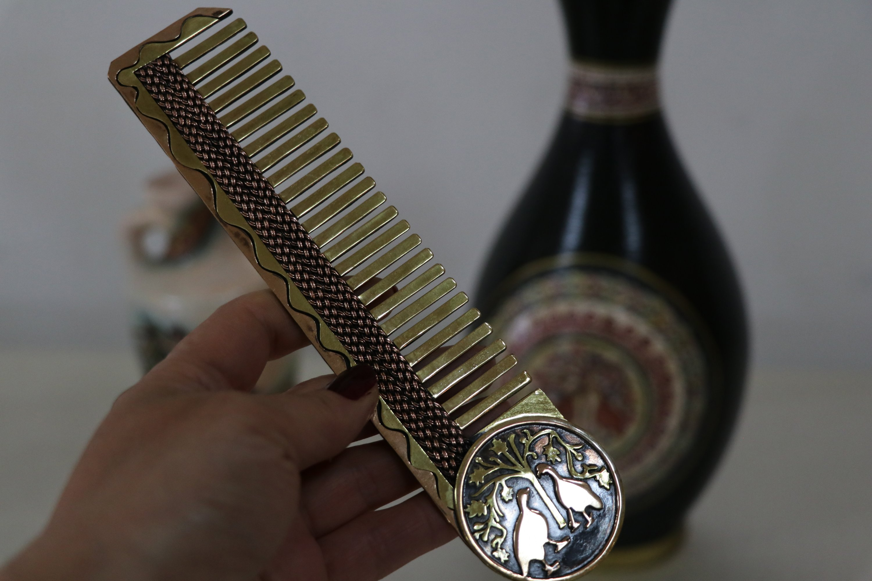 A comb decorated with Roman mosaic patterns at the Continuation Institute, Adana, southern Turkey, April 6, 2021. (AA Photo)