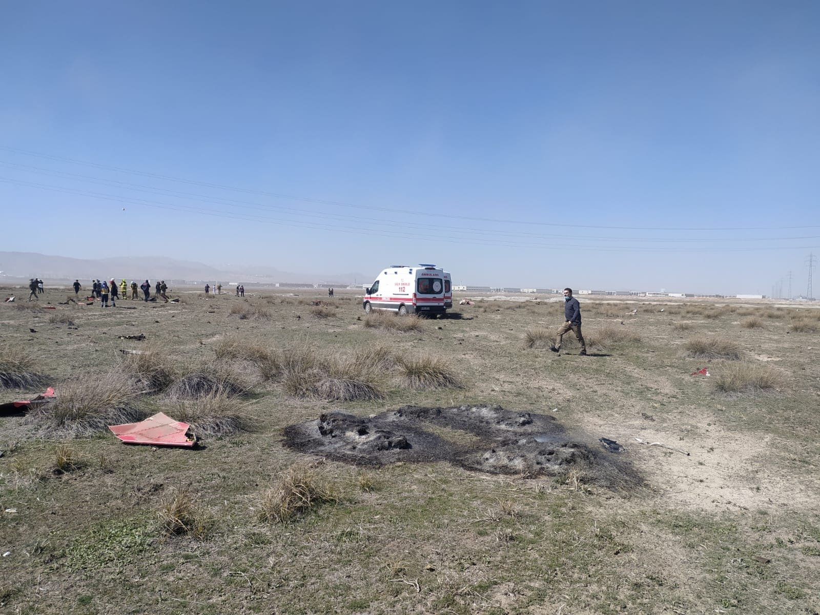 A view of the crash site where parts of the plane are scattered around, in Konya, central Turkey, Apr. 7, 2021. (AA PHOTO)