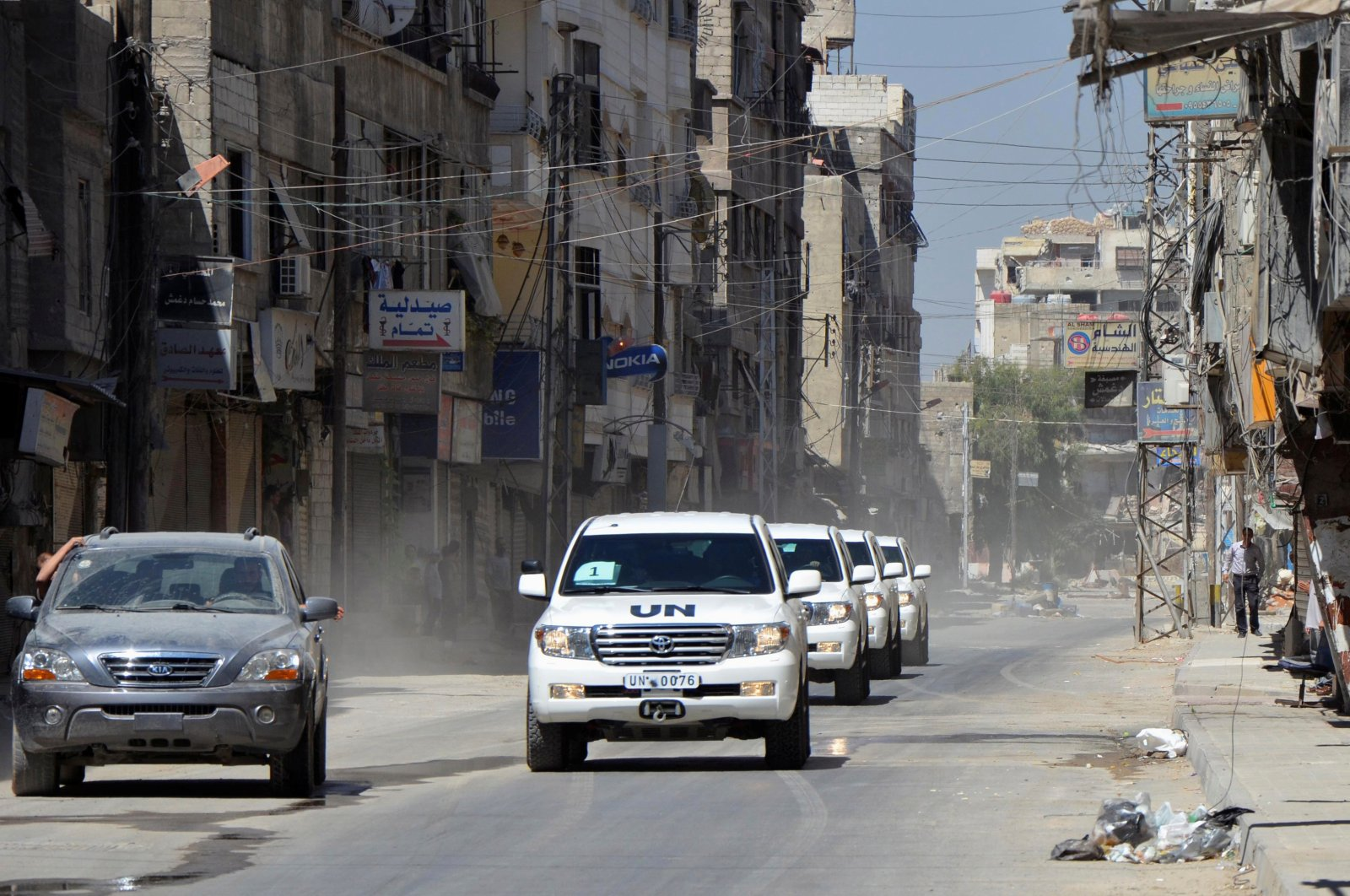 A convoy of United Nations vehicles carrying a team of U.N. chemical weapons experts and escorted by Free Syrian Army fighters drive through one of the sites of an alleged chemical weapons attack in eastern Ghouta in Damascus suburbs, Syria, Aug. 28, 2013. (Reuters Photo)