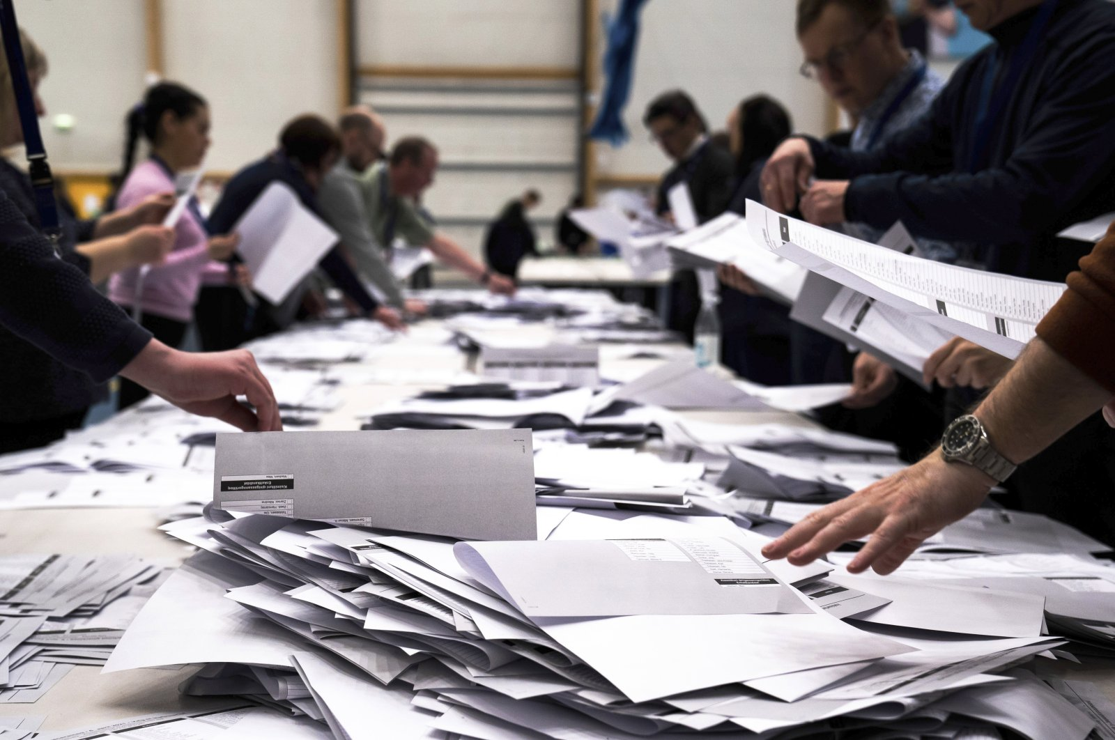 Electoral workers count ballots in a parliament election in Nuuk, Denmark, April 6, 2021. (AP Photo)