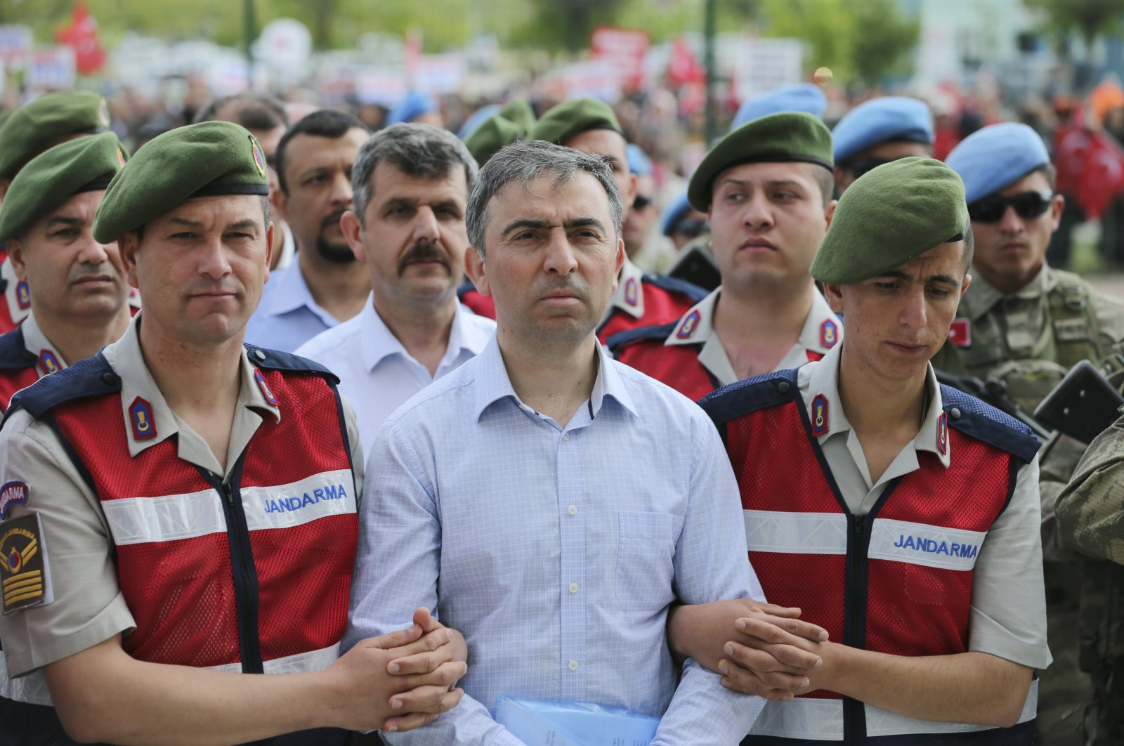 Muhsin Kutsi Barış, one of the defendants in the trial, is escorted to the courthouse for another coup-related trial, in the capital Ankara, Turkey, June 2, 2017. (AA PHOTO)