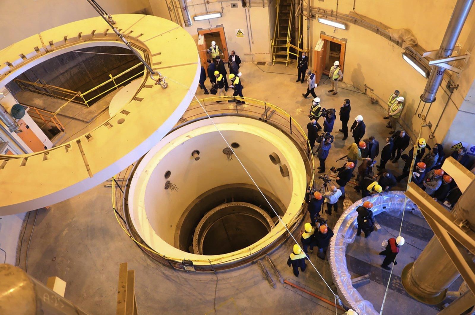Technicians at the Arak heavy water reactor's secondary circuit, show officials and media around the site, near Arak, 250 kilometers (150 miles) southwest of the capital Tehran, Iran, Dec. 23, 2019. (Atomic Energy Organization of Iran via AP)
