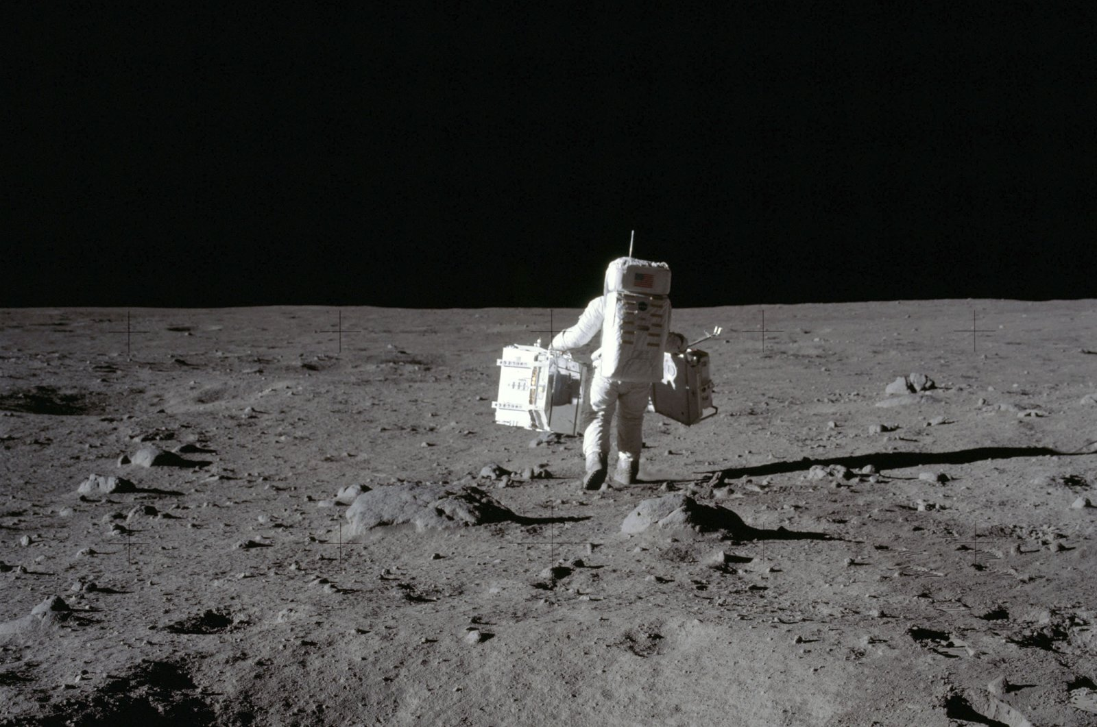 In this July 20, 1969 photo, American astronaut Buzz Aldrin walks on the surface of the Moon in the Tranquility Base area. (Neil Armstrong / NASA via AP)