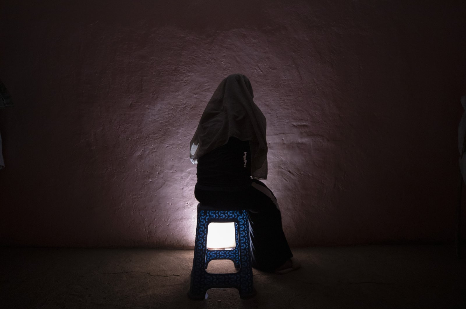 A Tigrayan refugee rape victim who fled the conflict in Ethiopia's Tigray sits for a portrait in eastern Sudan near the Sudan-Ethiopia border, on March 20, 2021. (AP Photo)