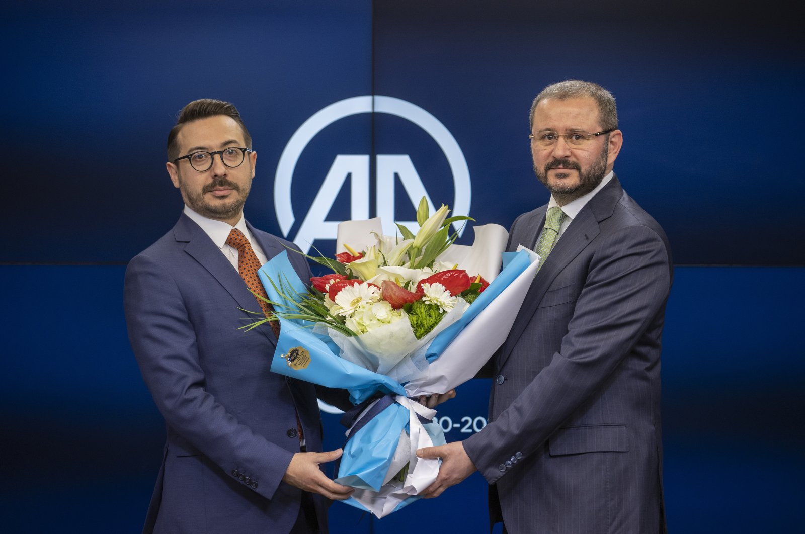 Serdar Karagöz (L) poses with his predecessor Şenol Kazancı at a handover ceremony, in the capital Ankara, Turkey, April 7, 2021. (AA PHOTO)