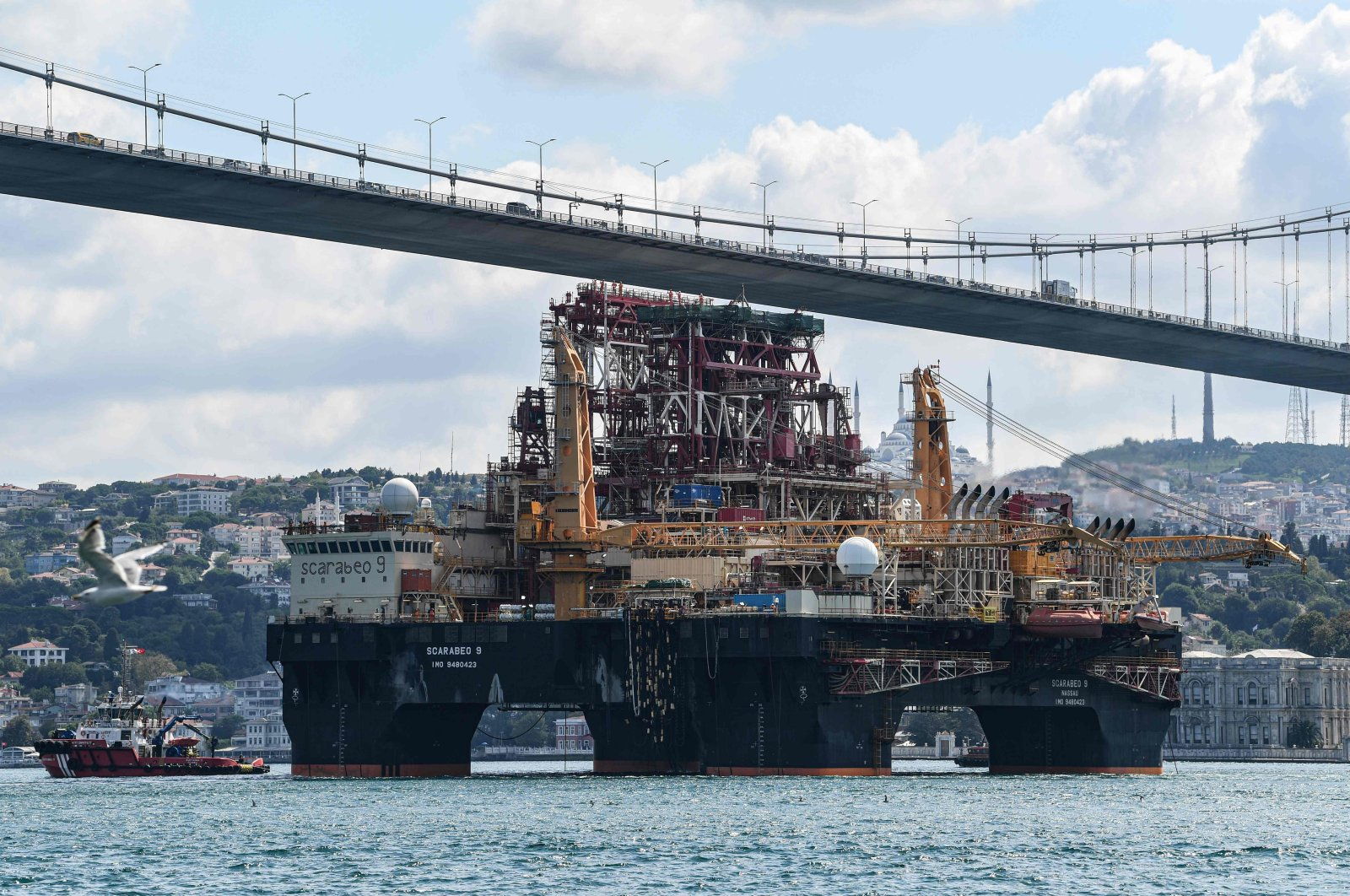 Scarabeo 9, a 115-meter-long and 78-meter-high Frigstad D90-type semi-submersible drilling rig, passes under the July 15th Martyrs Bridge on the Bosphorus Strait en route to the Black Sea, Istanbul, Turkey, Aug. 29, 2019. (AFP Photo)