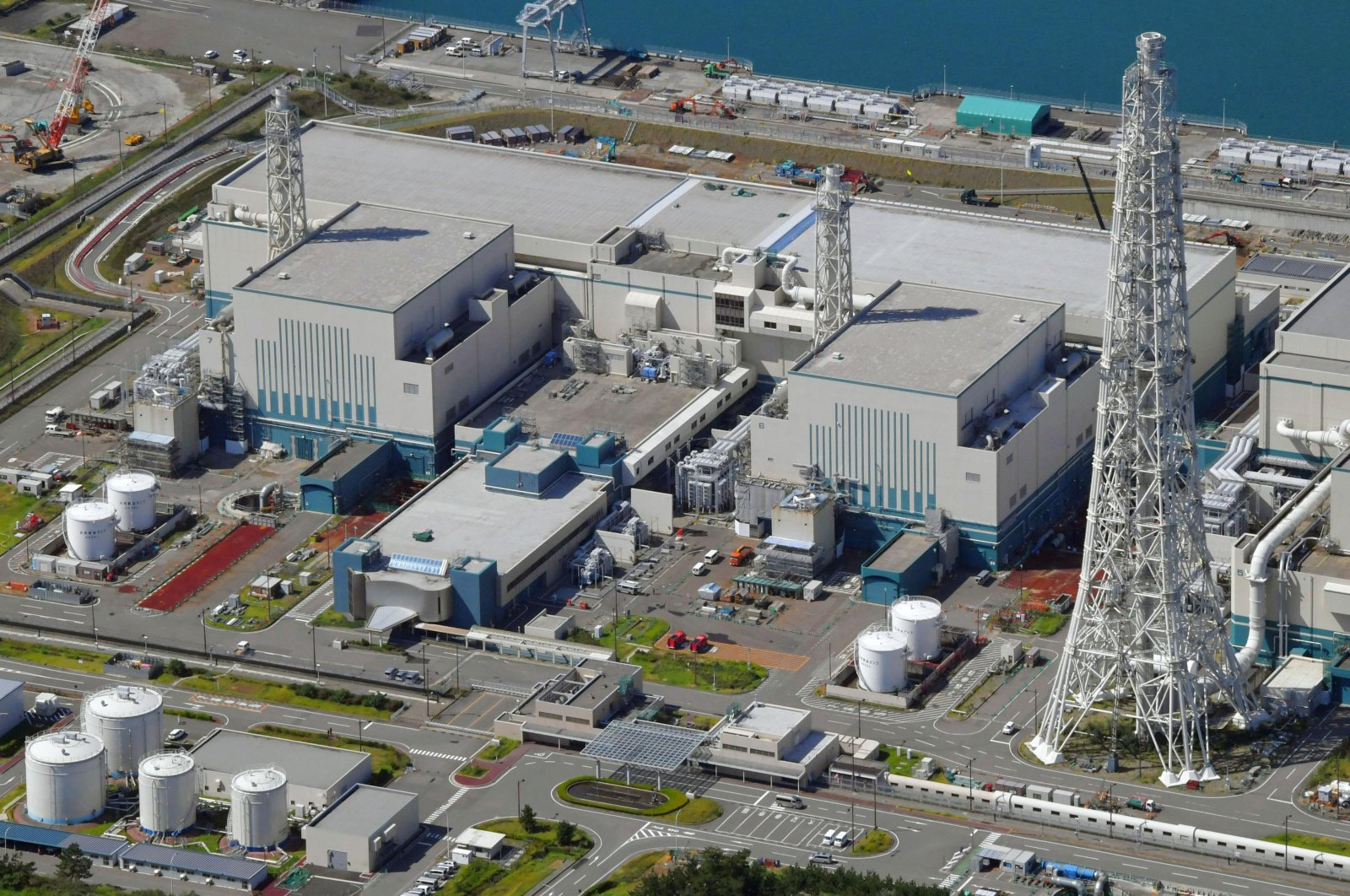 An aerial view shows the reactors of No. 6 (R) and No. 7 (L) at Kashiwazaki-Kariwa nuclear power plant, on the northern Japanese coast in Niigata prefecture, Japan, Sept. 30, 2017. (Kyodo News via AP)