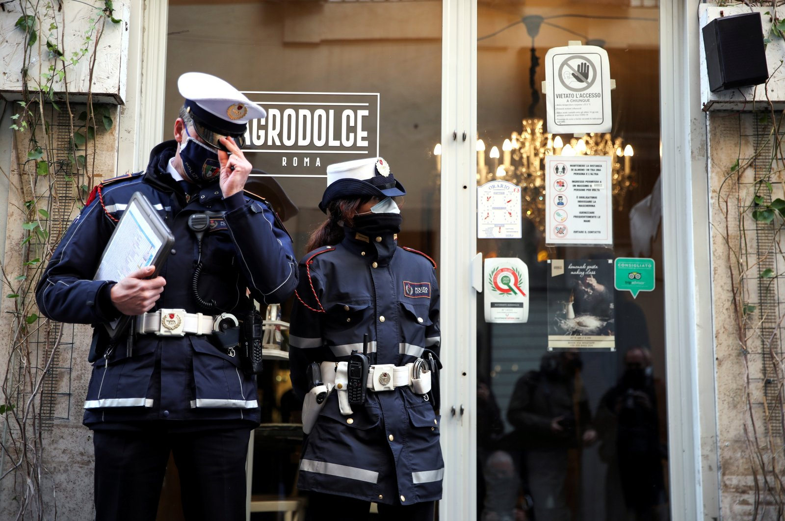 Municipal police stand outside a restaurant near the Trevi Fountain in Rome, Italy, April 7, 2021. (Reuters Photo)