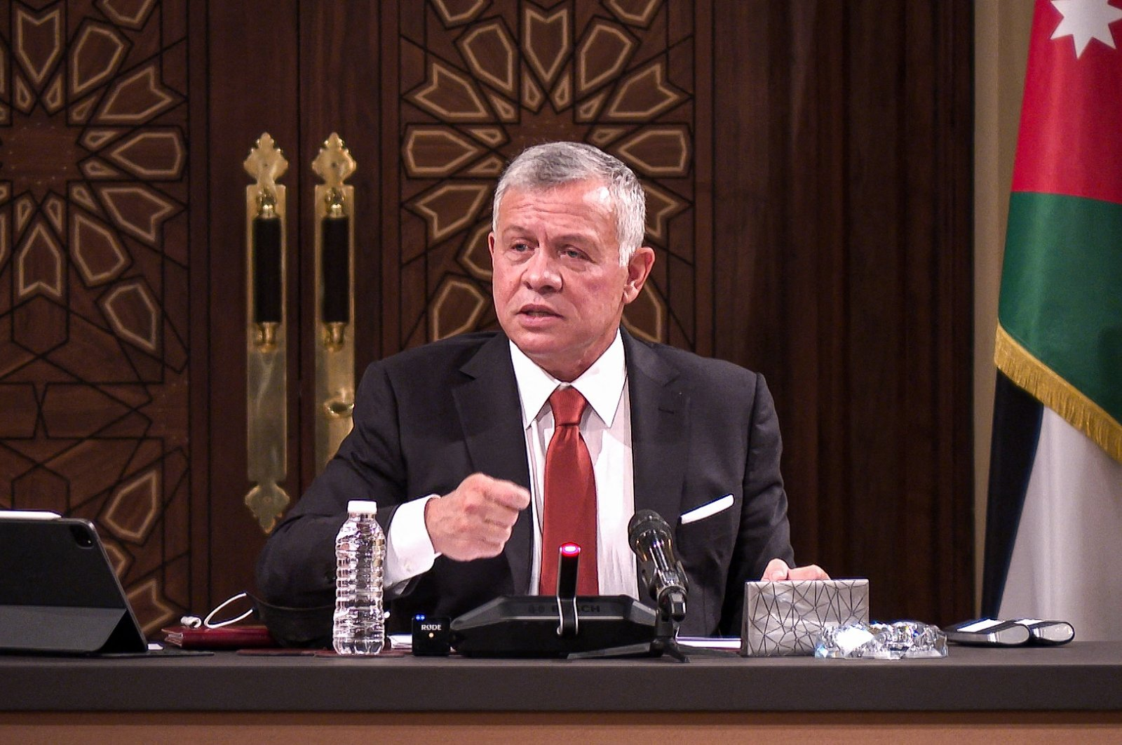 Jordanian King Abdullah II speaks during a meeting at the House of Representatives in the capital Amman, Jordan, March 23, 2021. (Jordanian Royal Palace via AFP)
