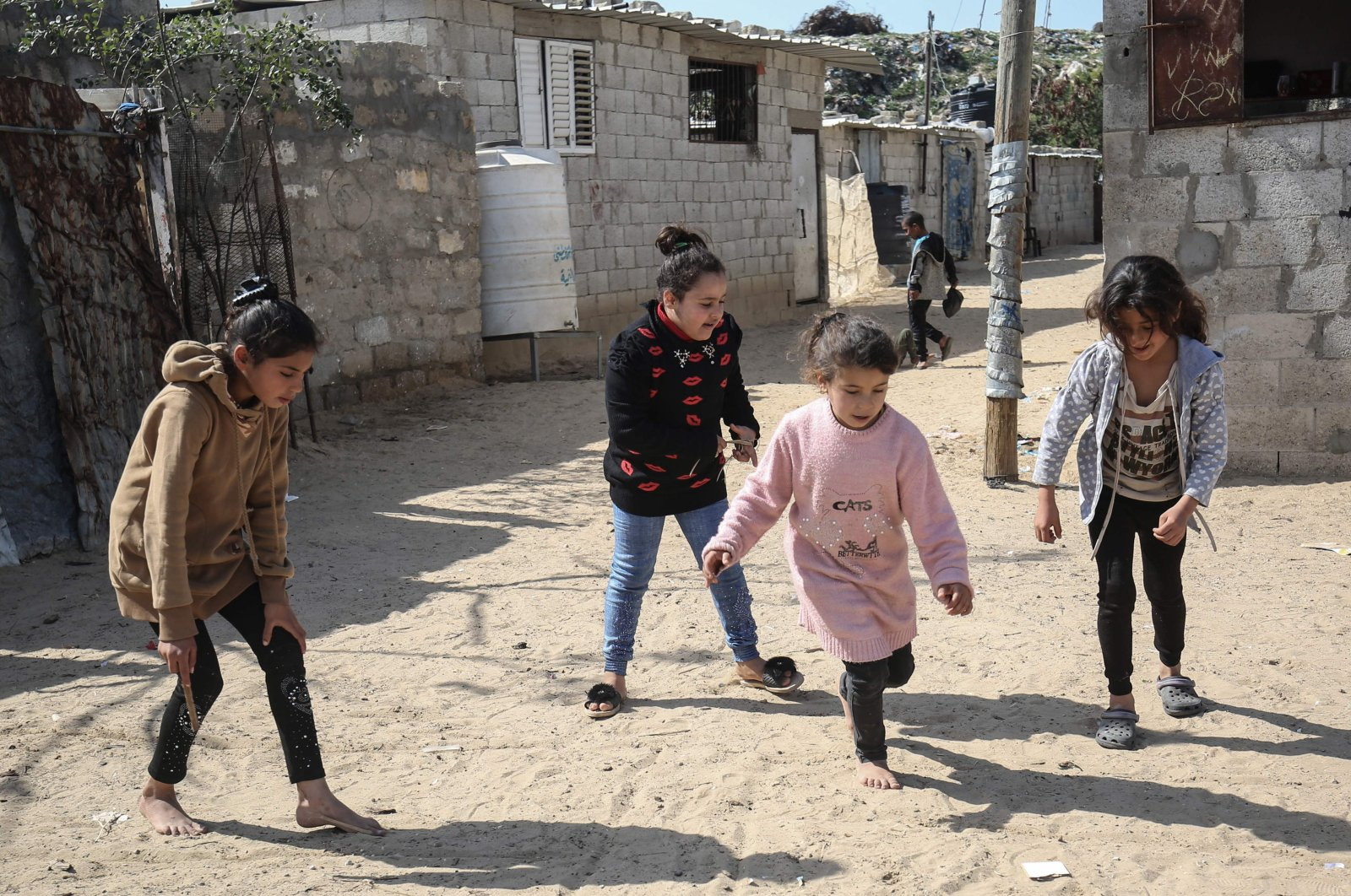 Palestinian girls play in a street in the Khan Younis camp for Palestinian refugees in the southern Gaza Strip, Palestine, Feb. 24, 2021. (AFP Photo)