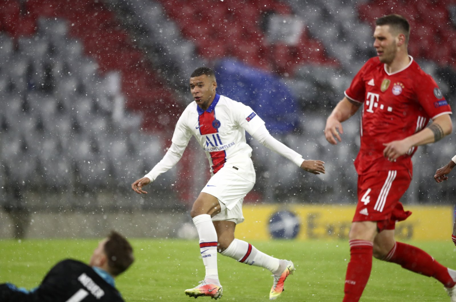 PSG's Kylian Mbappe (C) scores the opening goal of his team during the Champions League quarterfinal soccer match between Bayern Munich and Paris Saint Germain in Munich, Germany, April 7, 2021. (AP Photo)