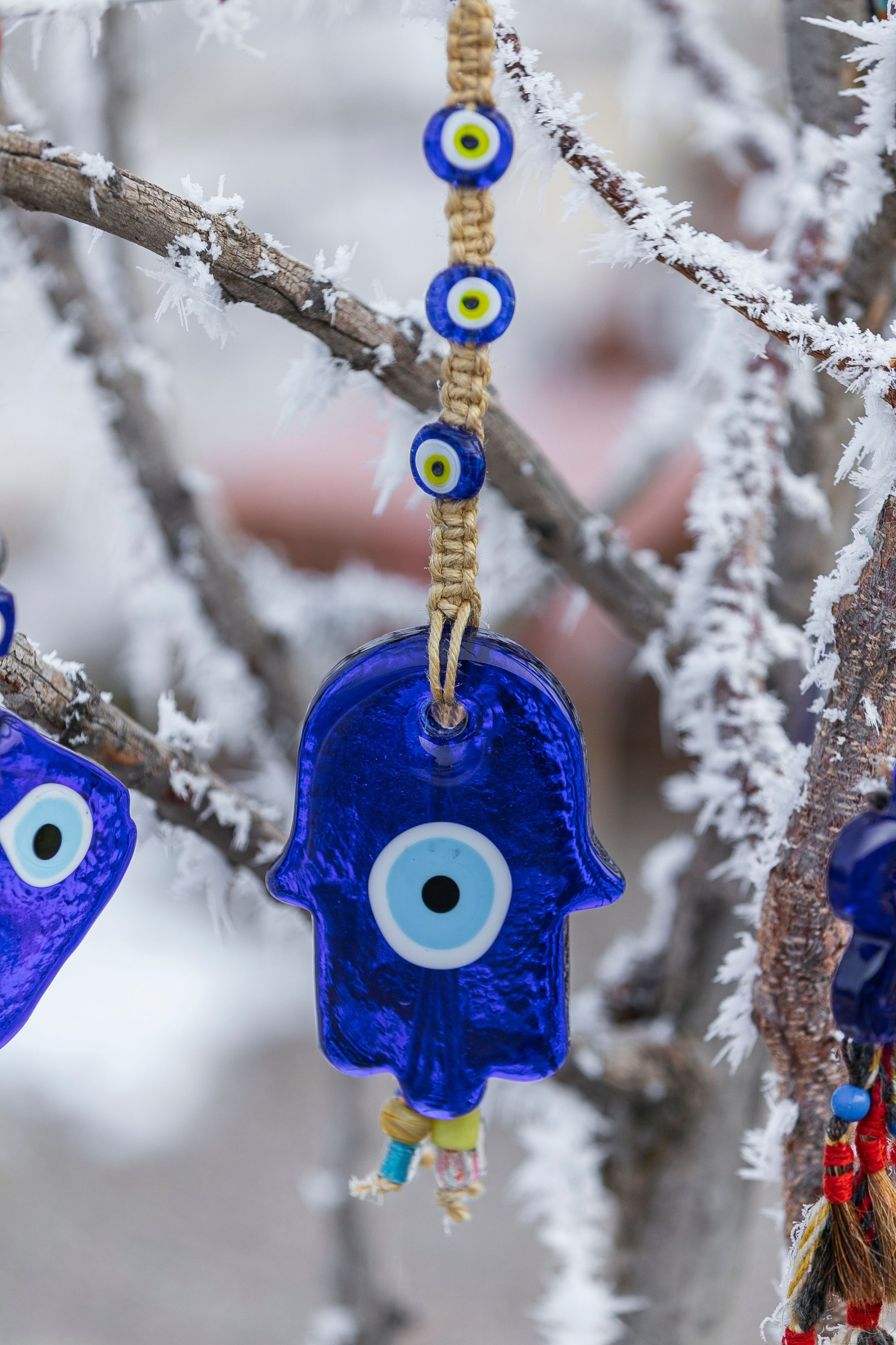 A small safety pin with a blue evil eye bead (or nazar boncuğu in Turkish) is always atatchjed to newborn babies' clothes. (Shutterstock Photo)