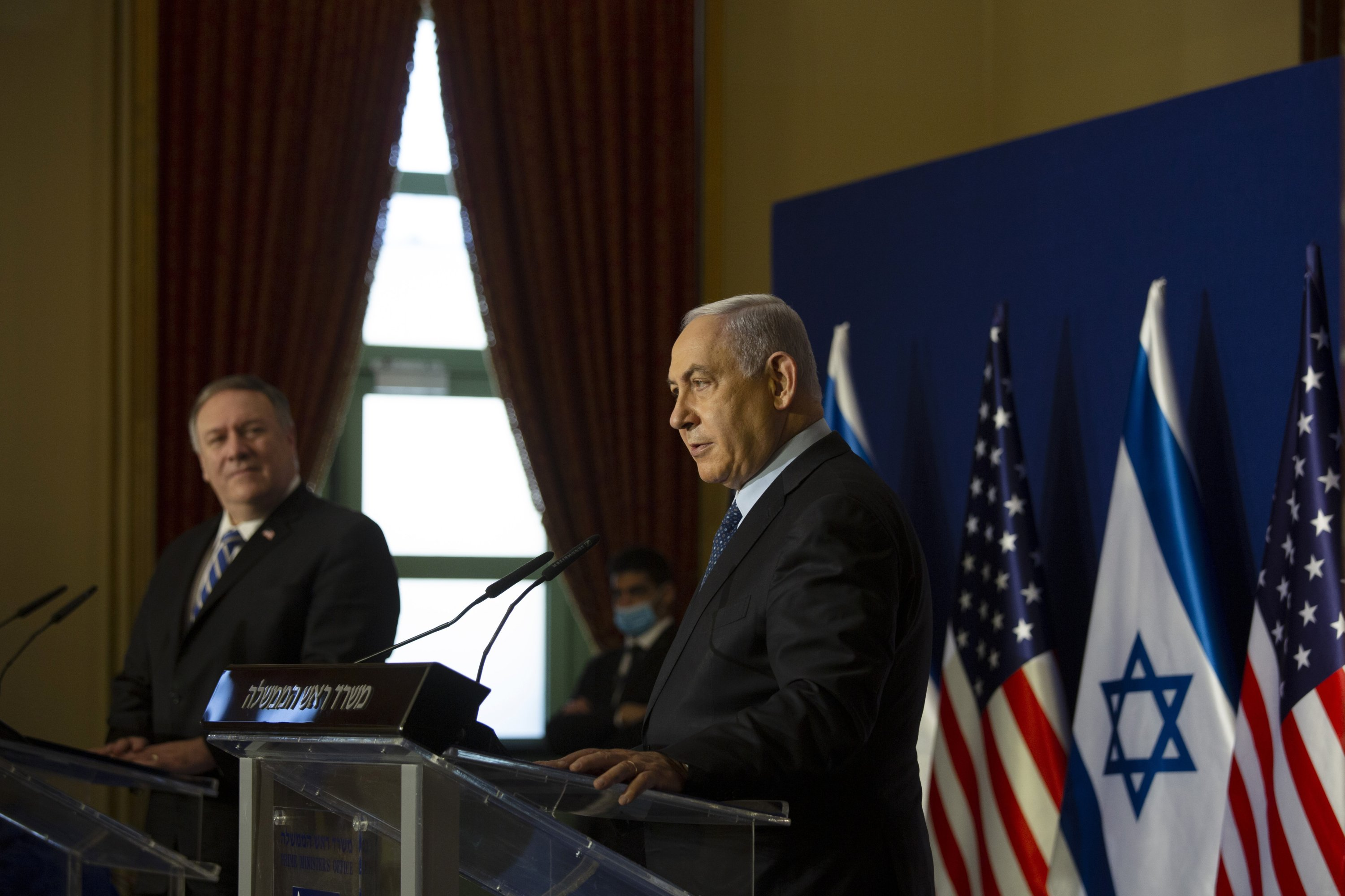 Then U.S. Secretary of State Mike Pompeo (L) listens to Israeli Prime Minister Benjamin Netanyahu speaking during their joint statement after meeting in Jerusalem, Nov. 19, 2020. (AP Photo)