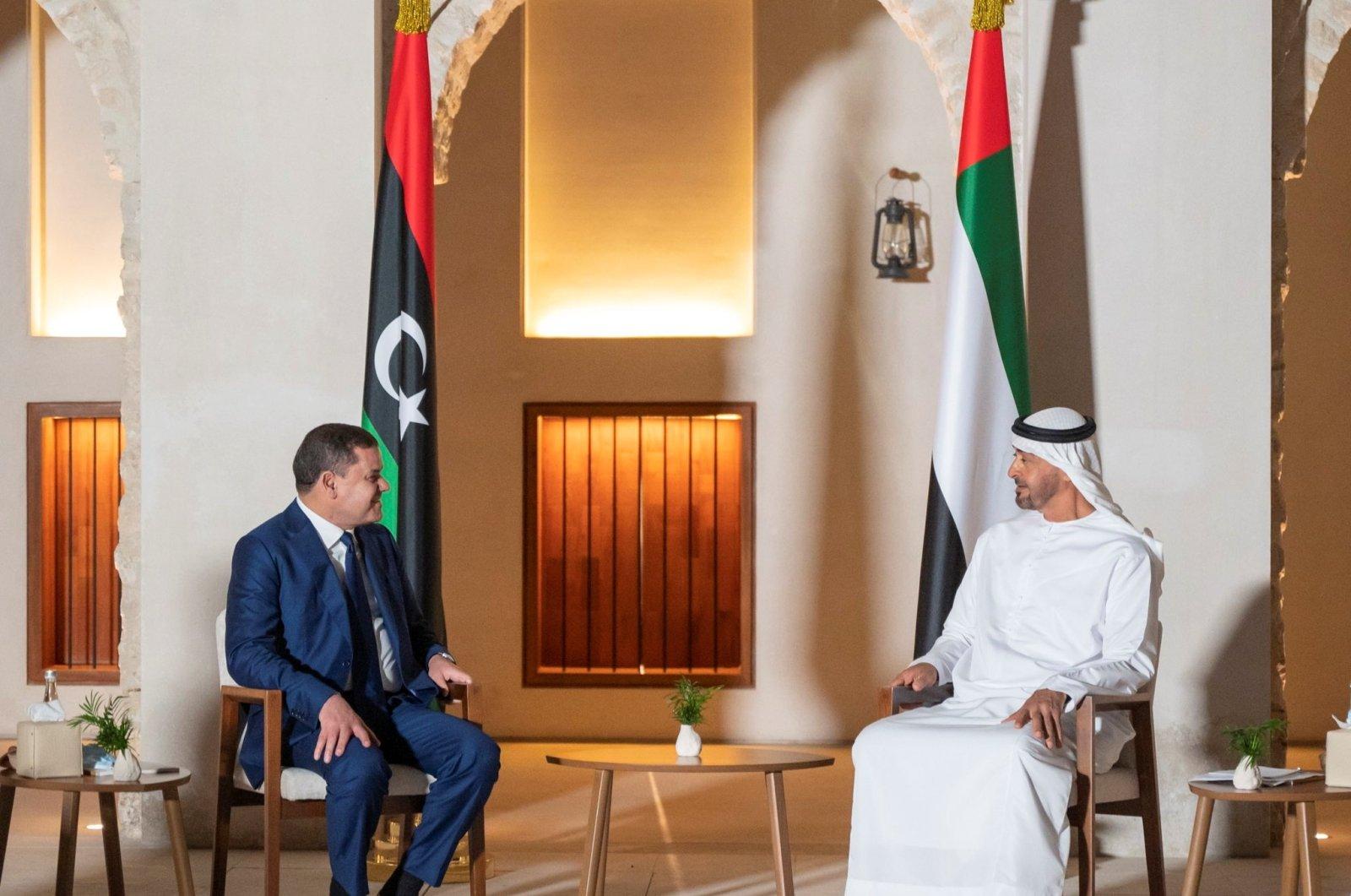 Abu Dhabi Crown Prince Sheikh Mohammed bin Zayed Al-Nahyan (R) receives Libya's interim Prime Minister Abdul Hamid Dbeibah in Abu Dhabi, the United Arab Emirates, April 7, 2021. (REUTERS Photo)