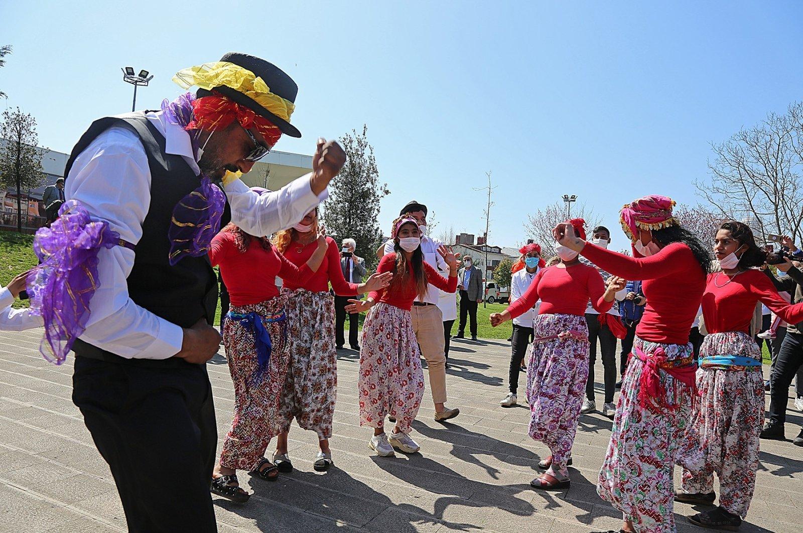 A group of Romani citizens celebrates International Roma Day in Ataşehir district, in Istanbul, Turkey, April 8, 2021. (İHA PHOTO)